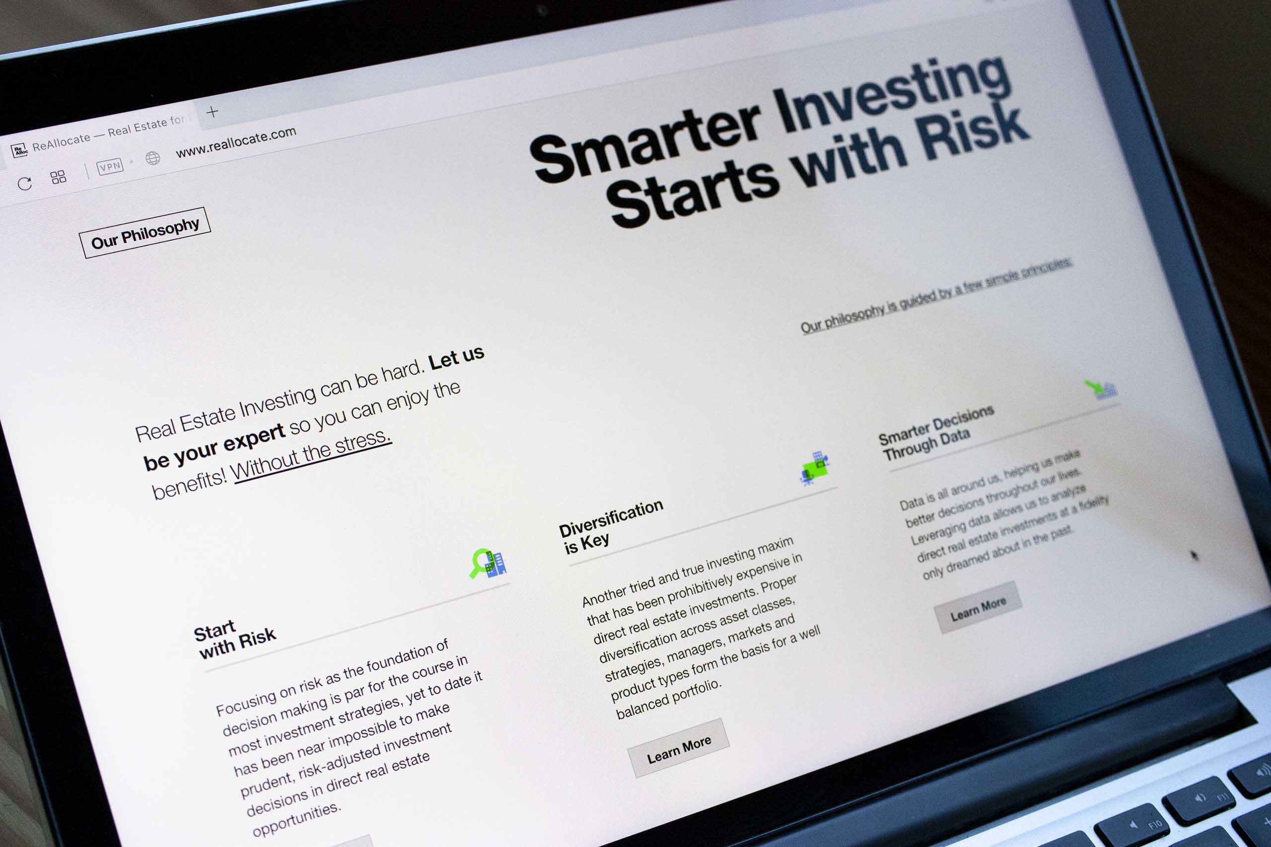 "A close up of ""Smarter Investing"" section with a three column layout describing risk, diversification, and data — by Dima Yagnyuk."