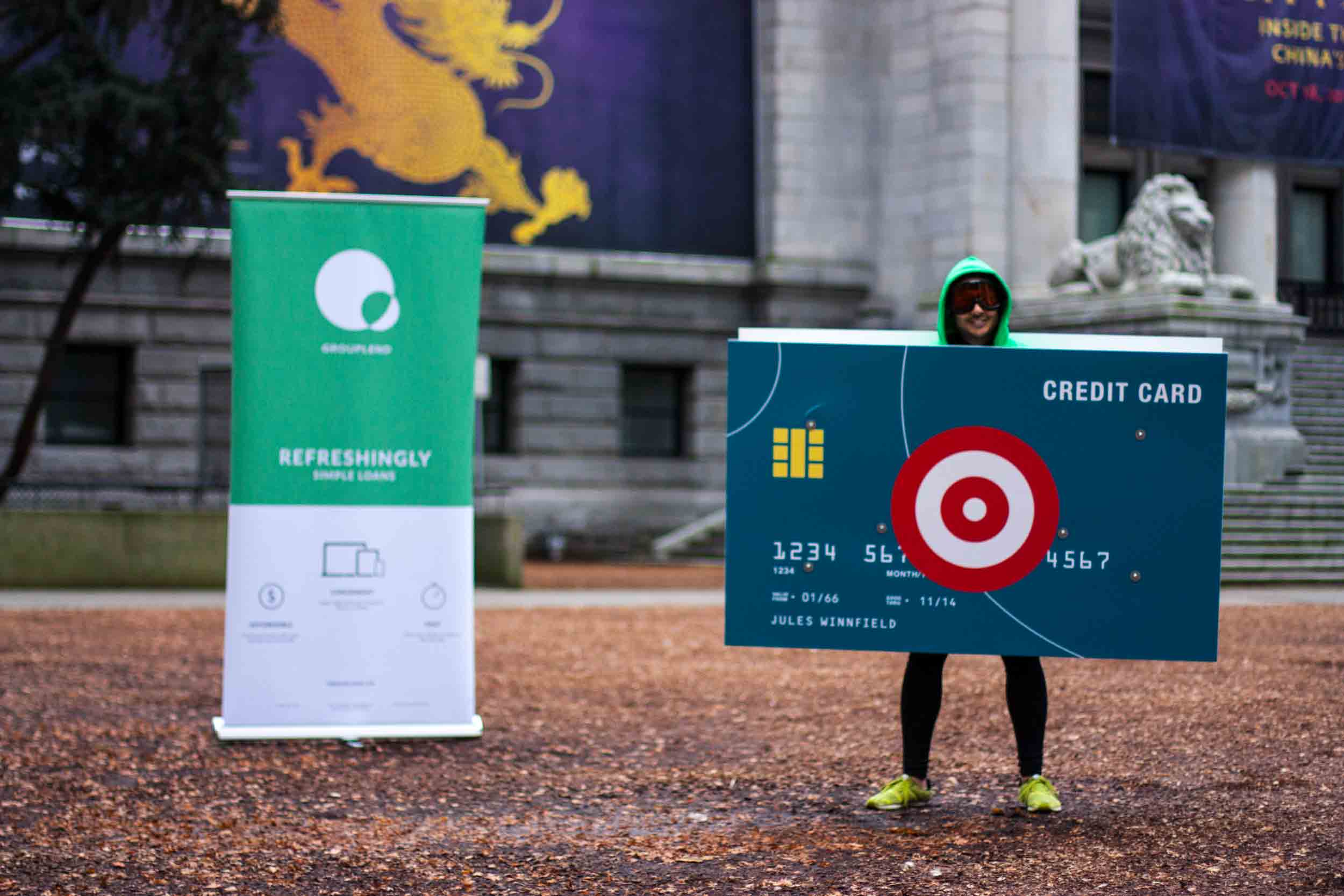 Grow Financial's CEO in credit card costume at the Vancouver Art Gallery ready to be pummelled by water balloons as part of an advertising event — by Yagnyuk.