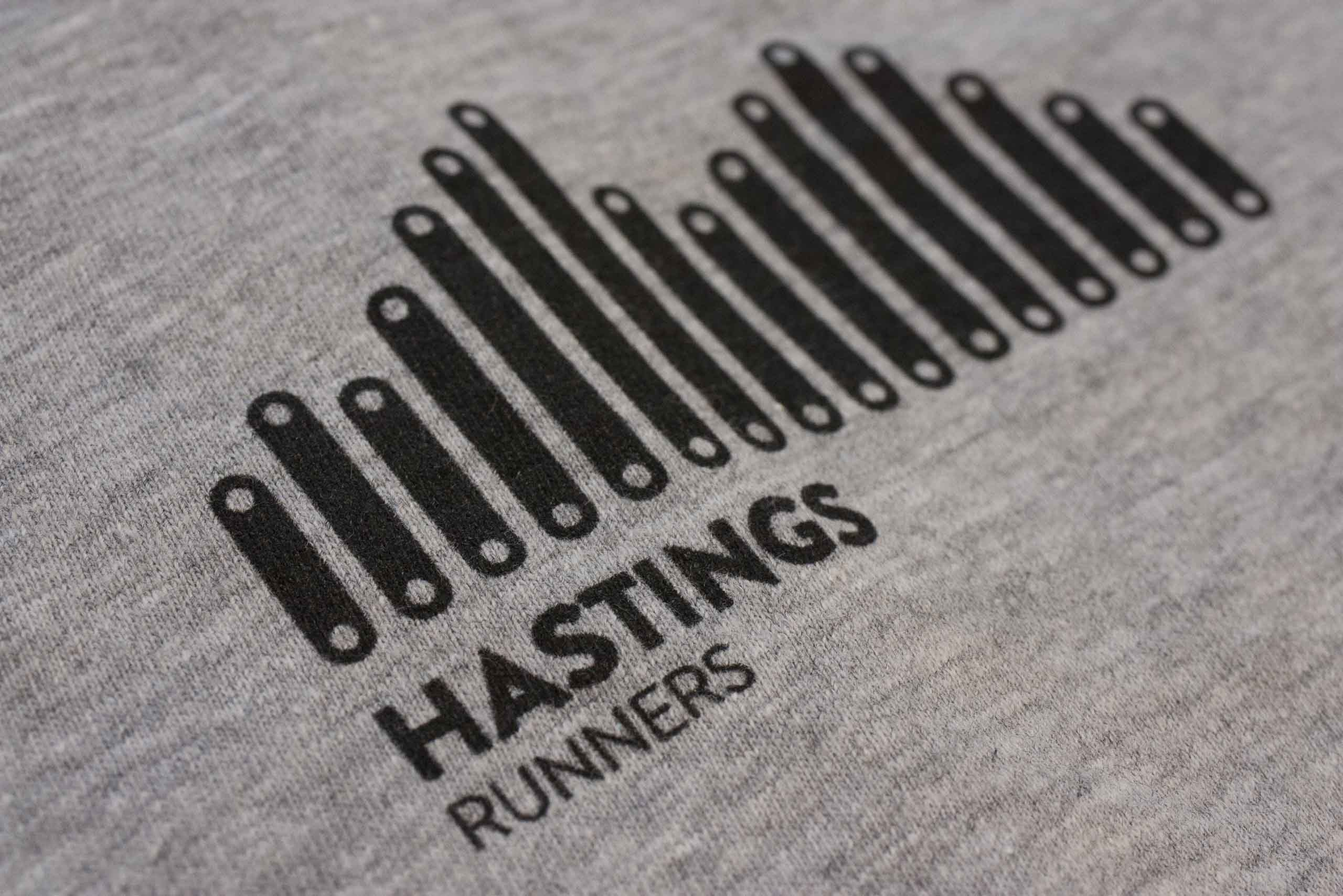 Macro shot of the Hastings Runners logo printed on the shirt showing the intricate detailing — by Yagnyuk.