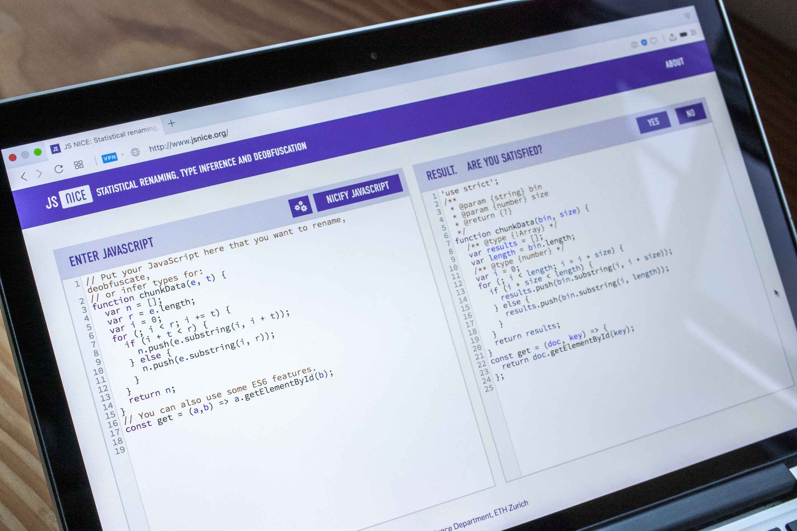 Photograph of the JS Nice application screen on a laptop showing the full details the the purple brand accents — by Yagnyuk.