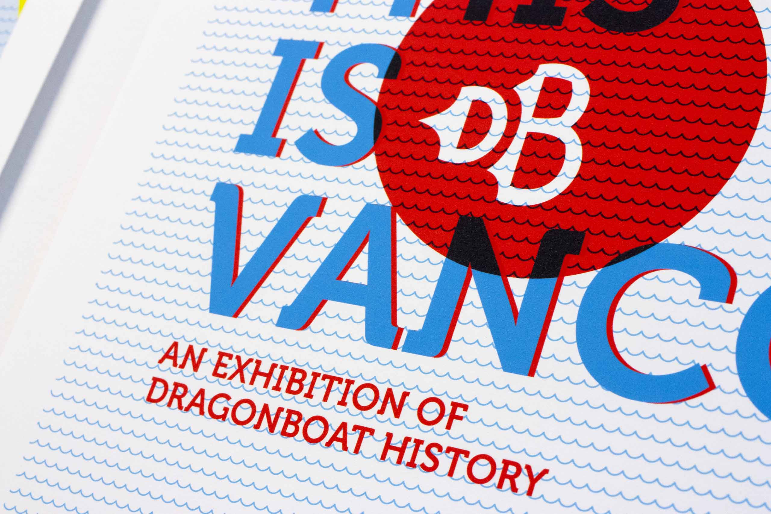 Close up of 'this is vancouver, an exhibition of dragonboat history' poster headline set against blue waves— by Yagnyuk.