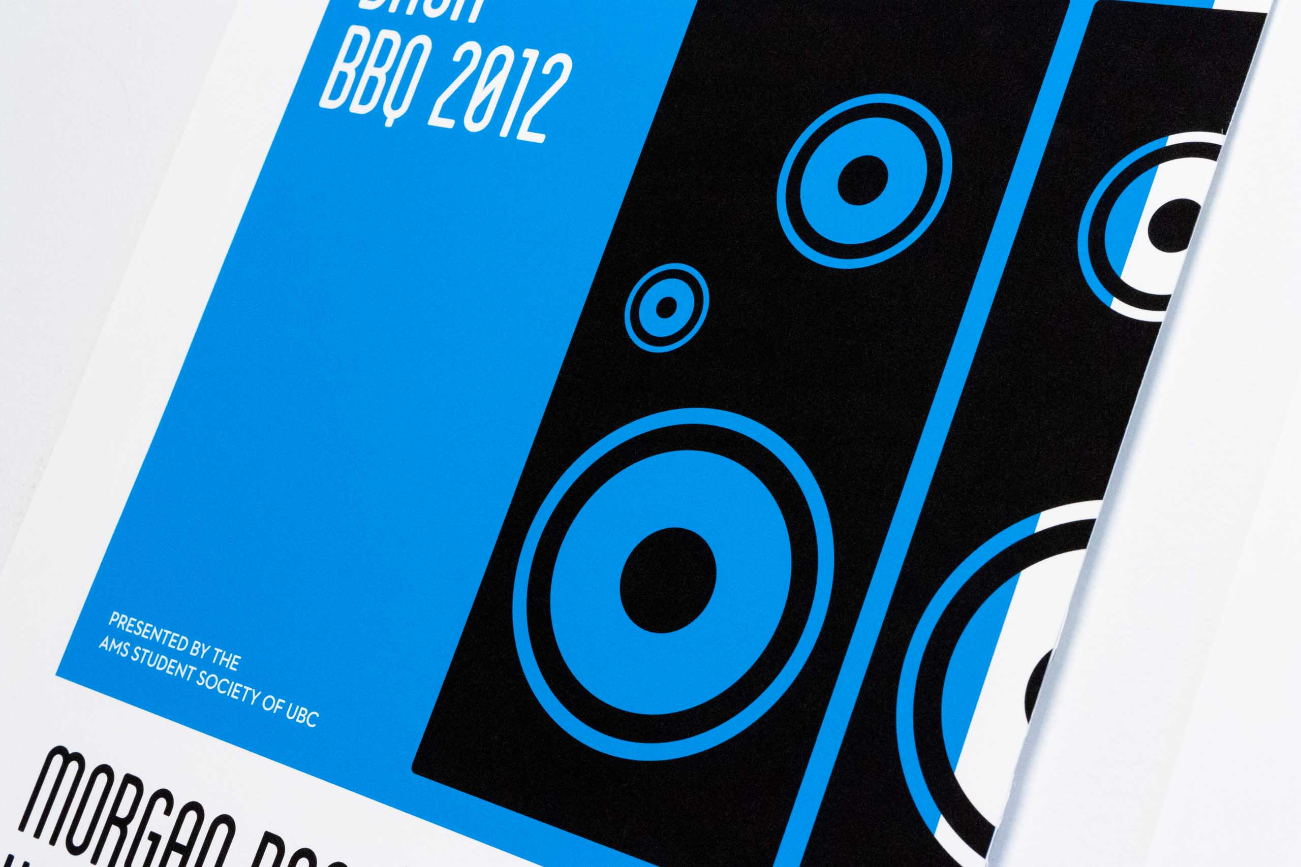 Close up of the speakers illustration on the blue poster for UBC Music Festival — by Yagnyuk.