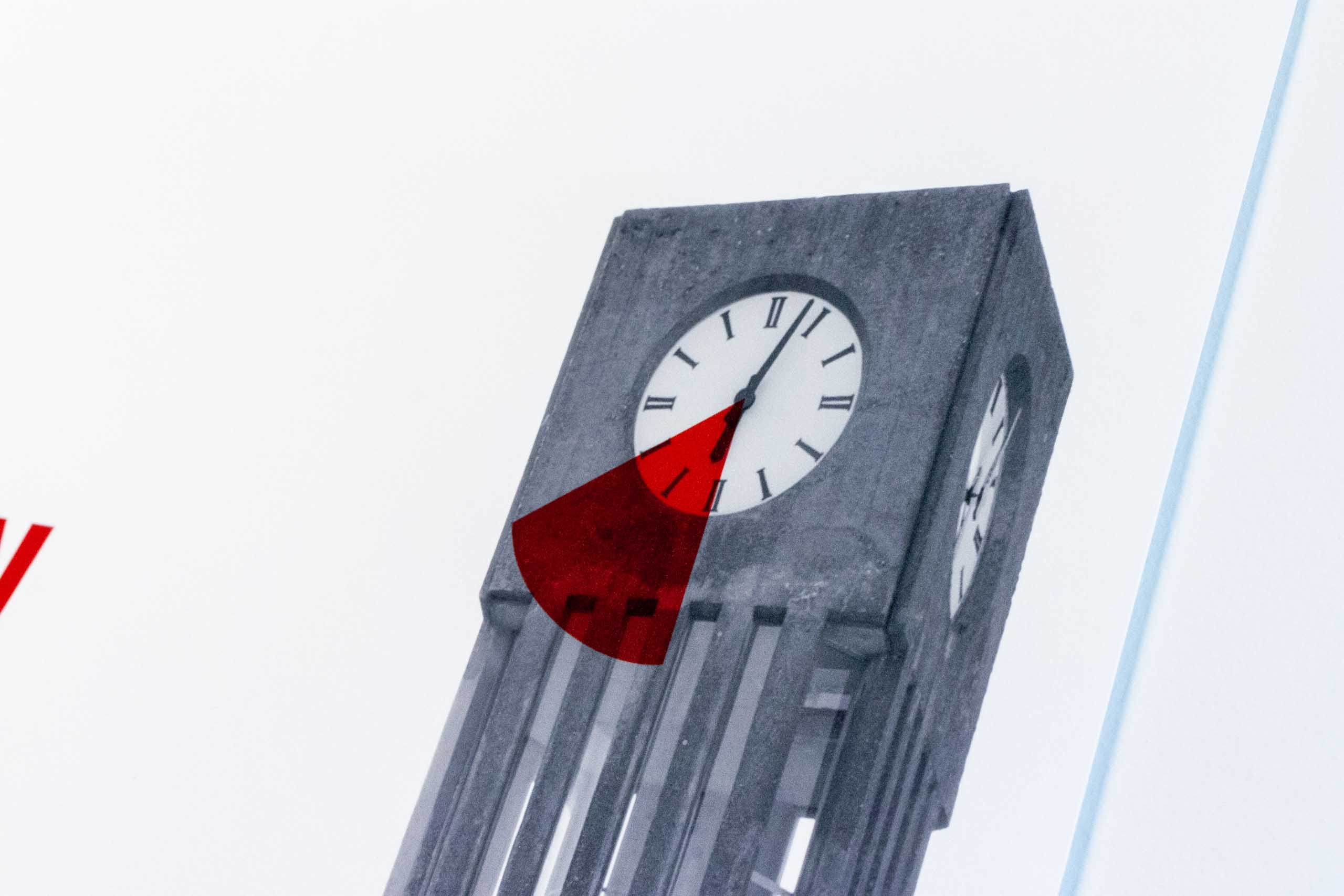 Close up photo of UBC clock tower with event time highlighted in red — by Yagnyuk.