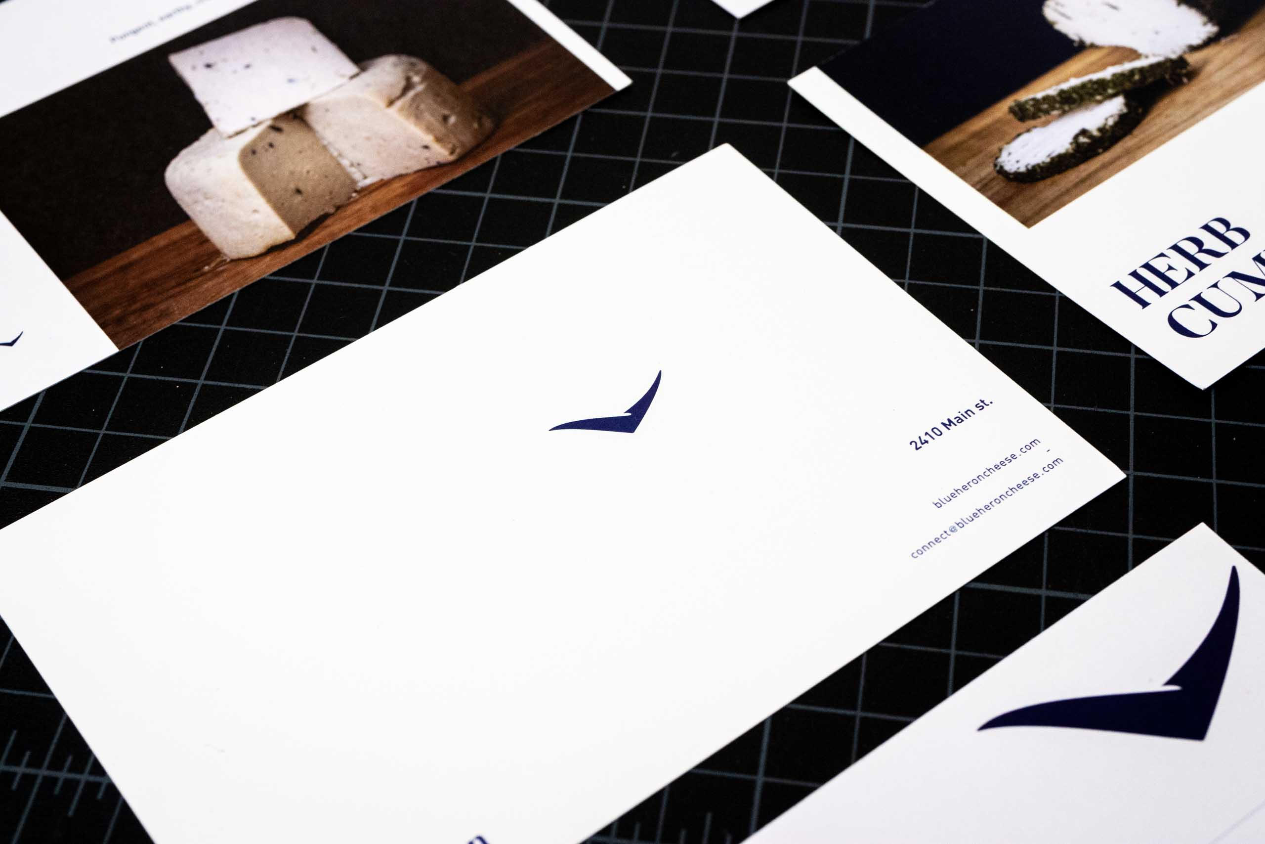 Postcard featuring a small Blue Heron logo, address and contact information — by Yagnyuk.