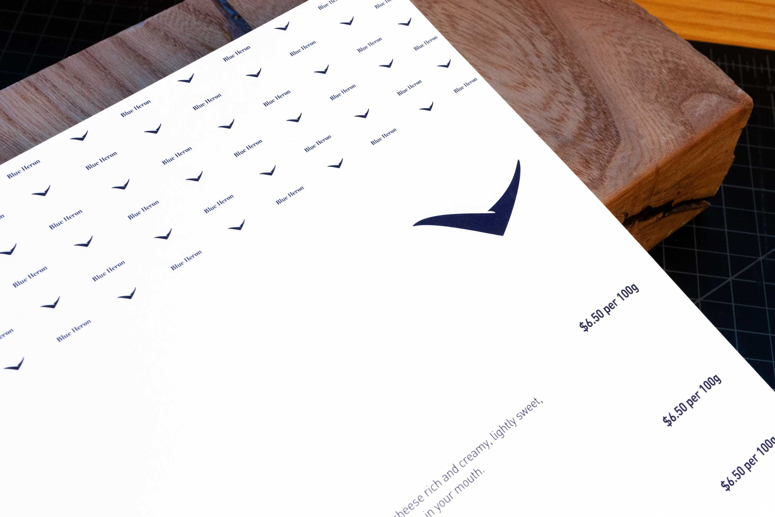 Top corner of the product menu showing Blue Heron logo and brand pattern — by Yagnyuk.