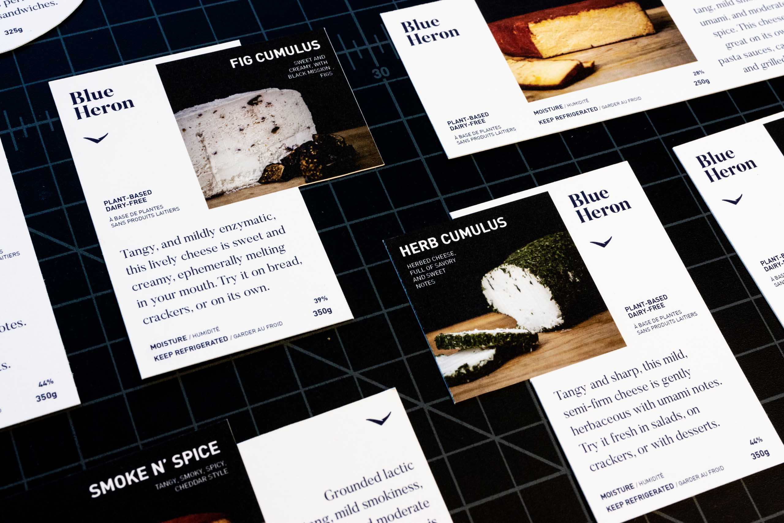 Blue Heron Cheese Labels closeup showing typography details, cheese photography, and flavour write-ups — by Yagnyuk.