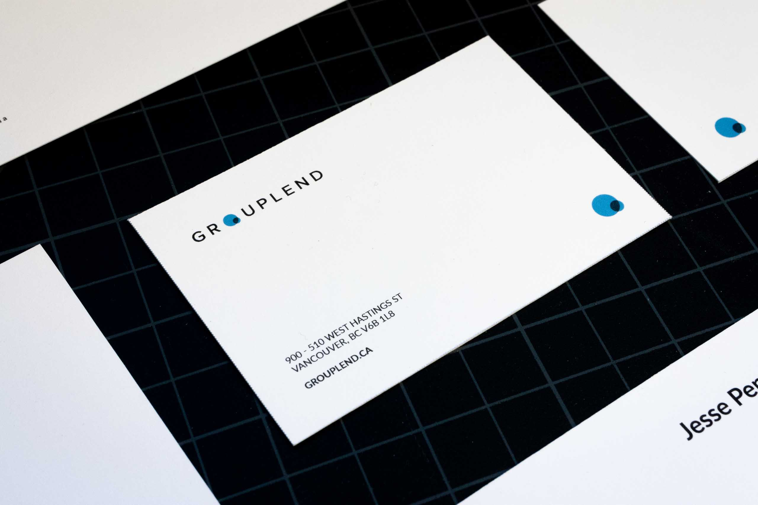 Close up of the Grouplend Business card informational side featuring company address, website and logo — by Yagnyuk.
