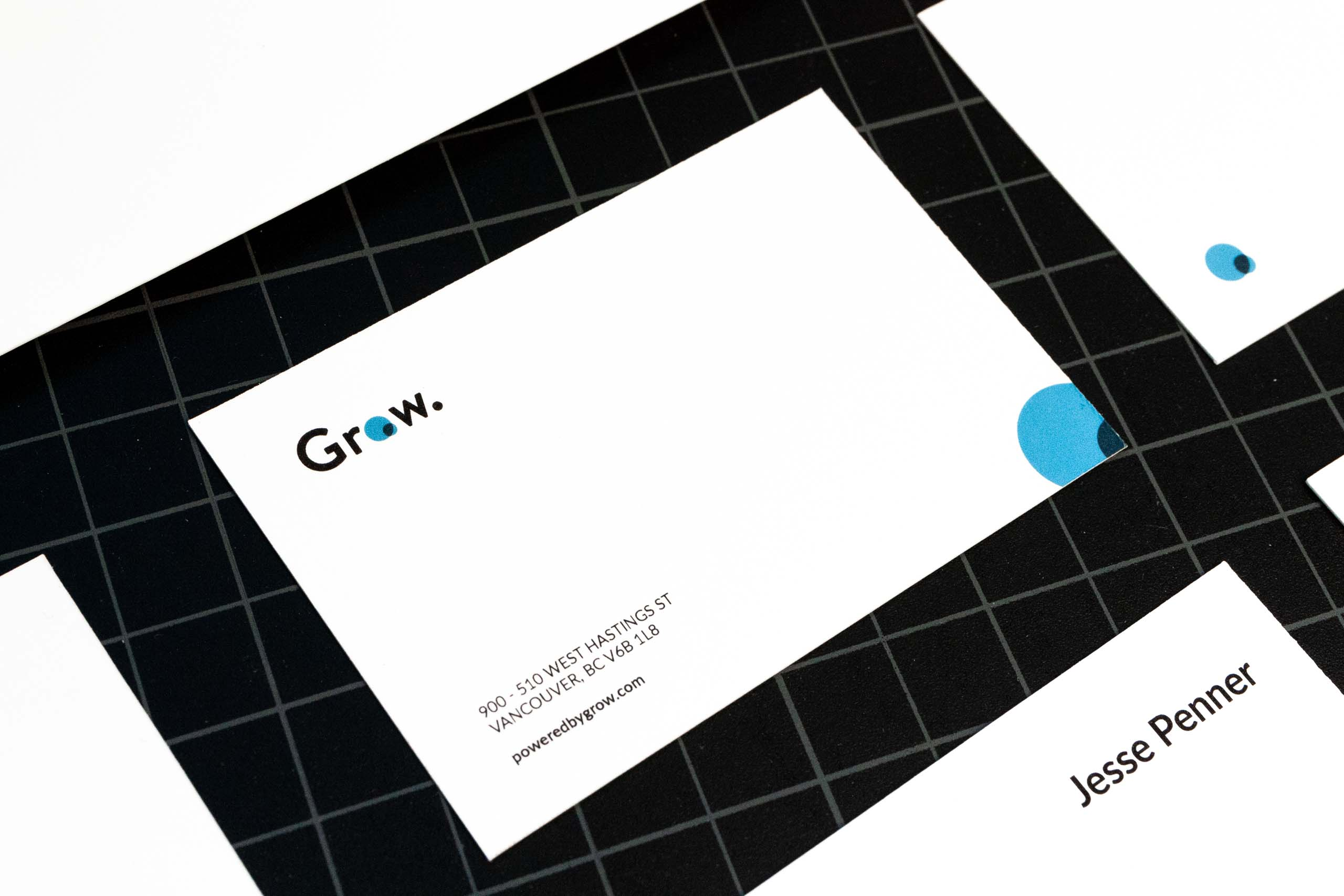 "Close up of the Grow business card detailing company contact information with ""venn diagram"" logo — by Yagnyuk."