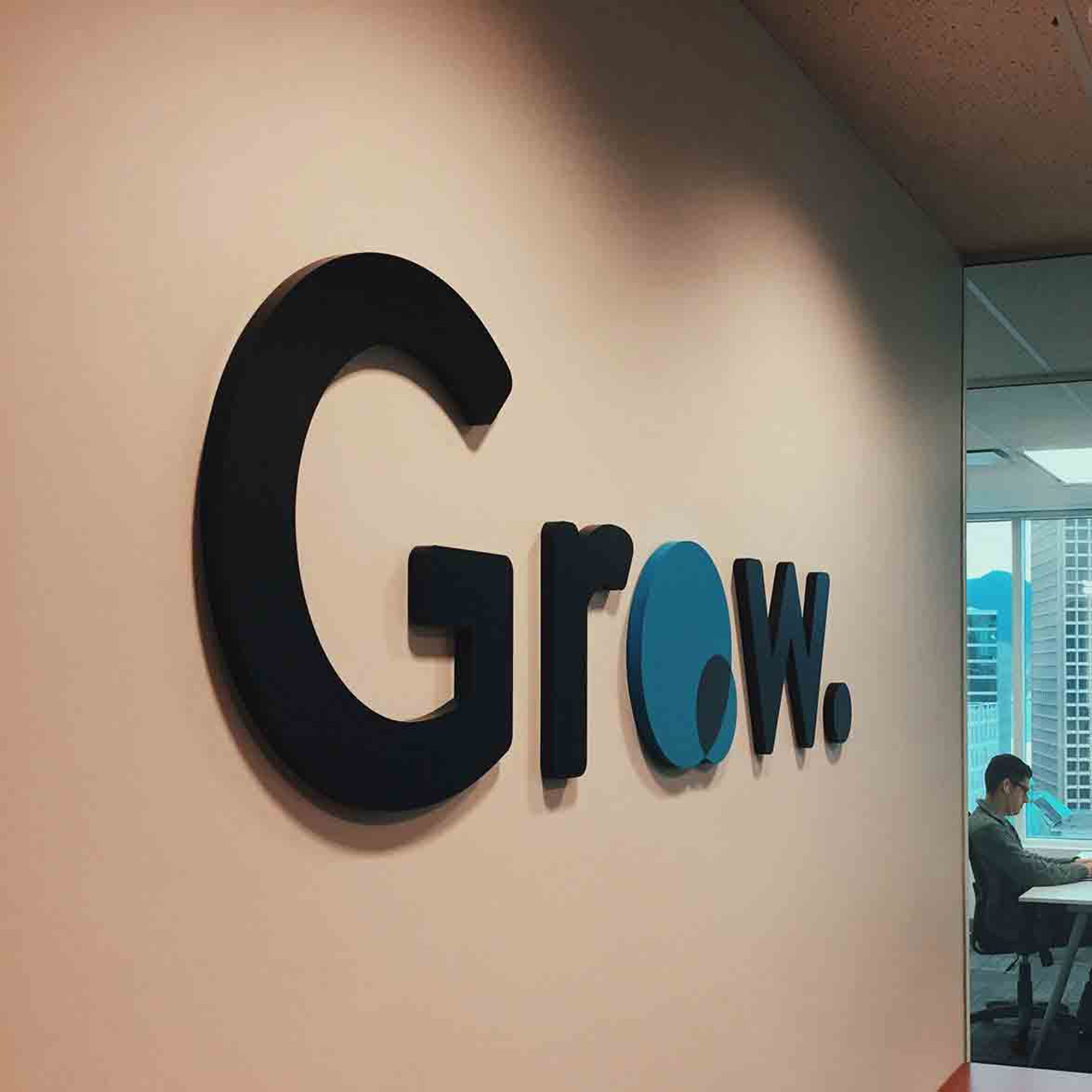 Grow Technologies office logo installed as a physical sign at their Vancouver headquarters — by Yagnyuk.