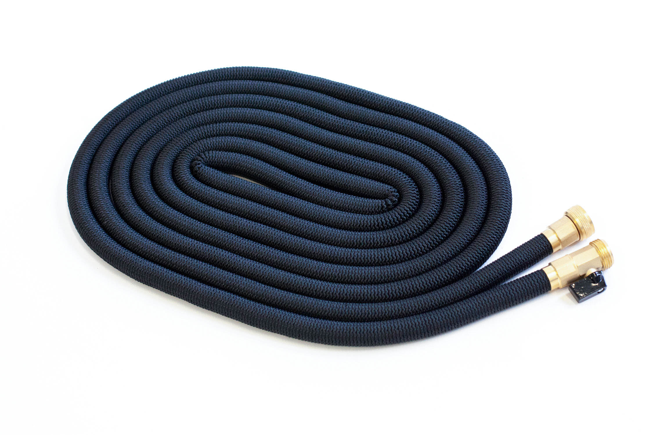 Hose flat on the ground coiled into an oval — by Yagnyuk.