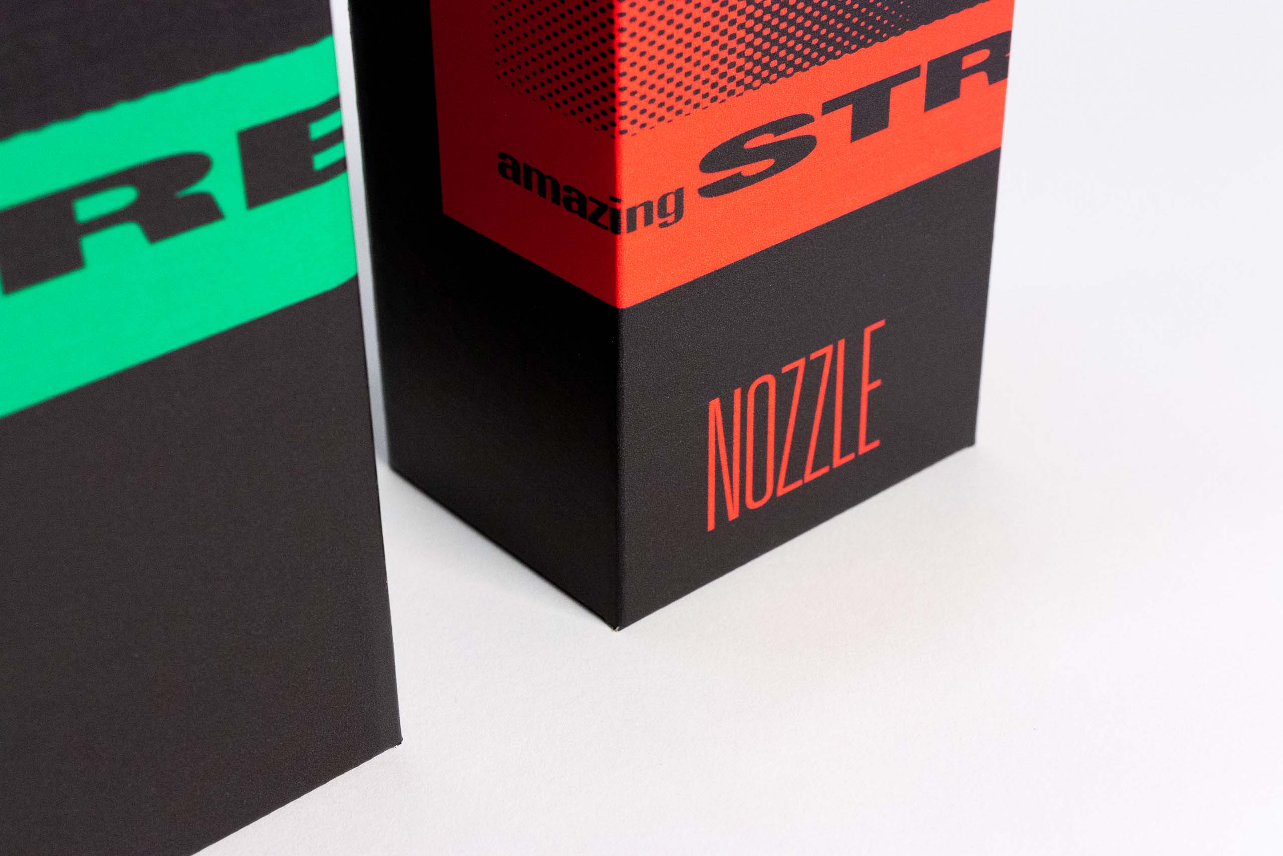 Details of The Nozzle typography below the brand logo encompassing most of the packaging — by Yagnyuk.