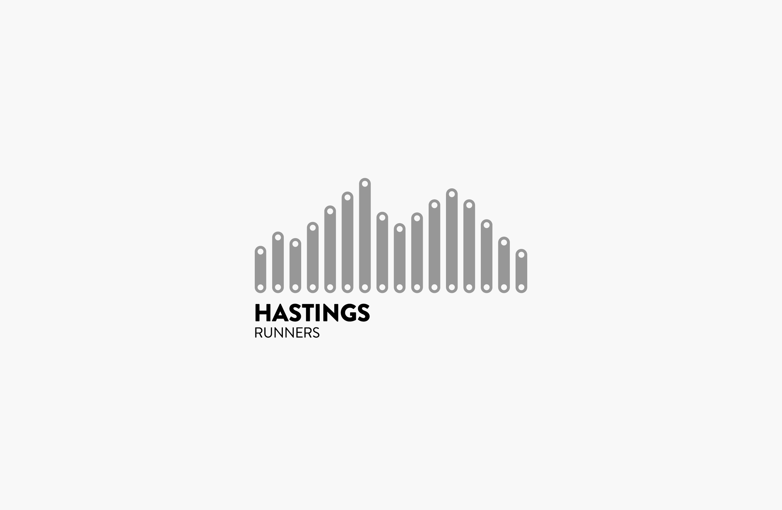 Hasting Runners logo centered on a grey background — by Yagnyuk.