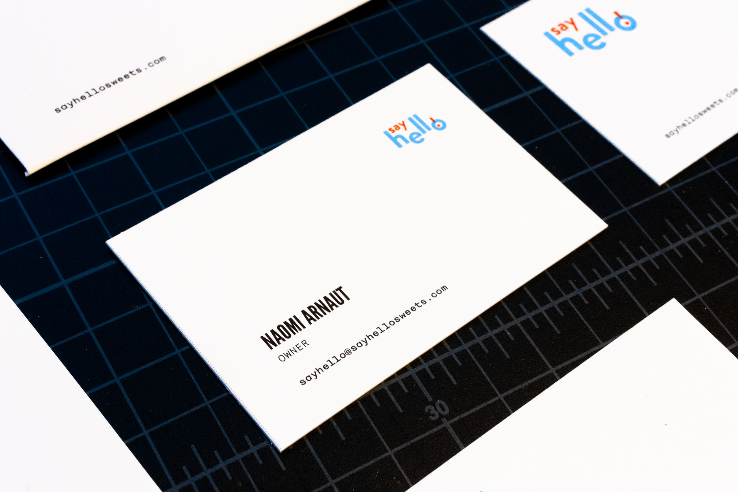 Front of the business card featuring Name, contact information and looking eye logo peering at them from the opposite corner — by Yagnyuk.