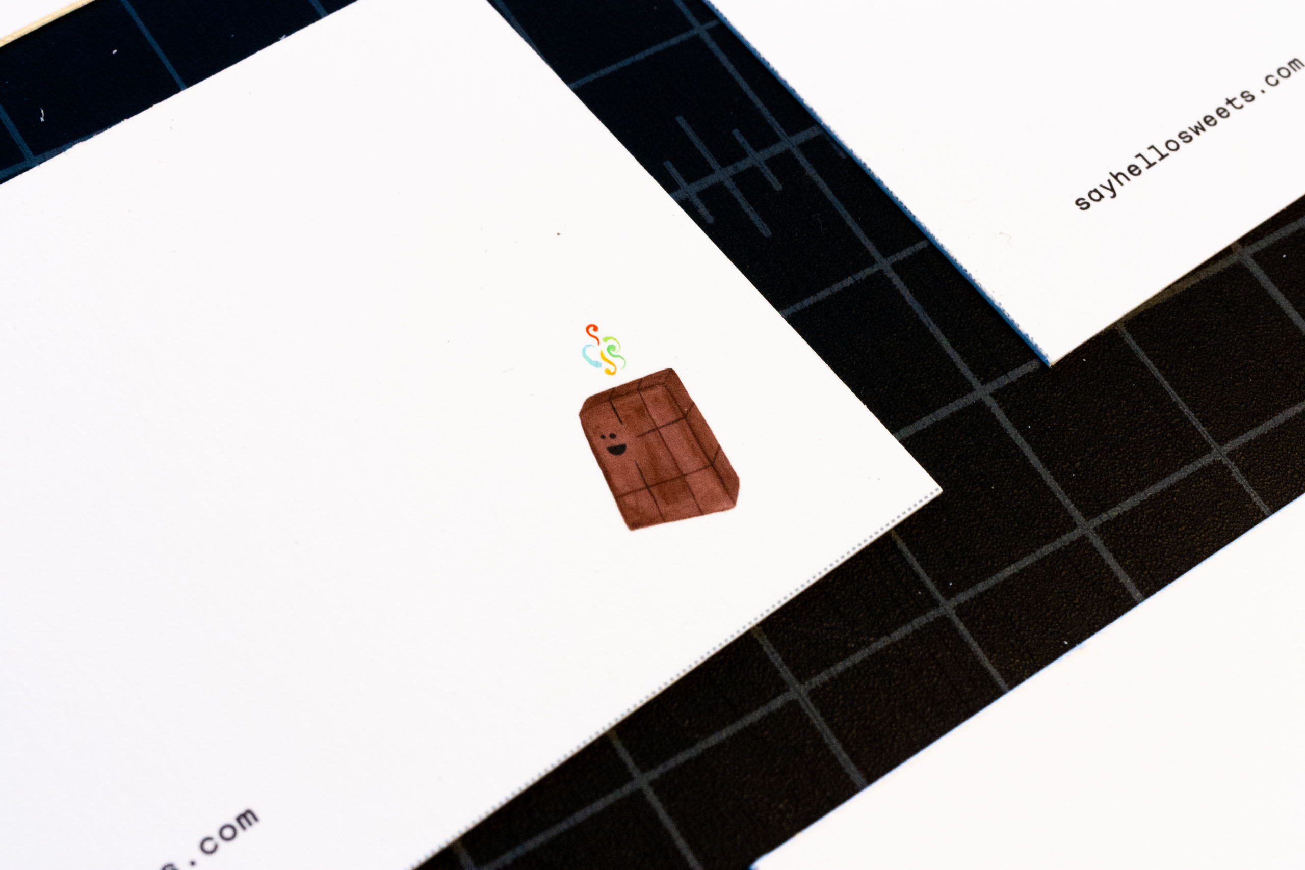 Close up of a business card corner with an illustration for chocolate nirvana — by Yagnyuk.