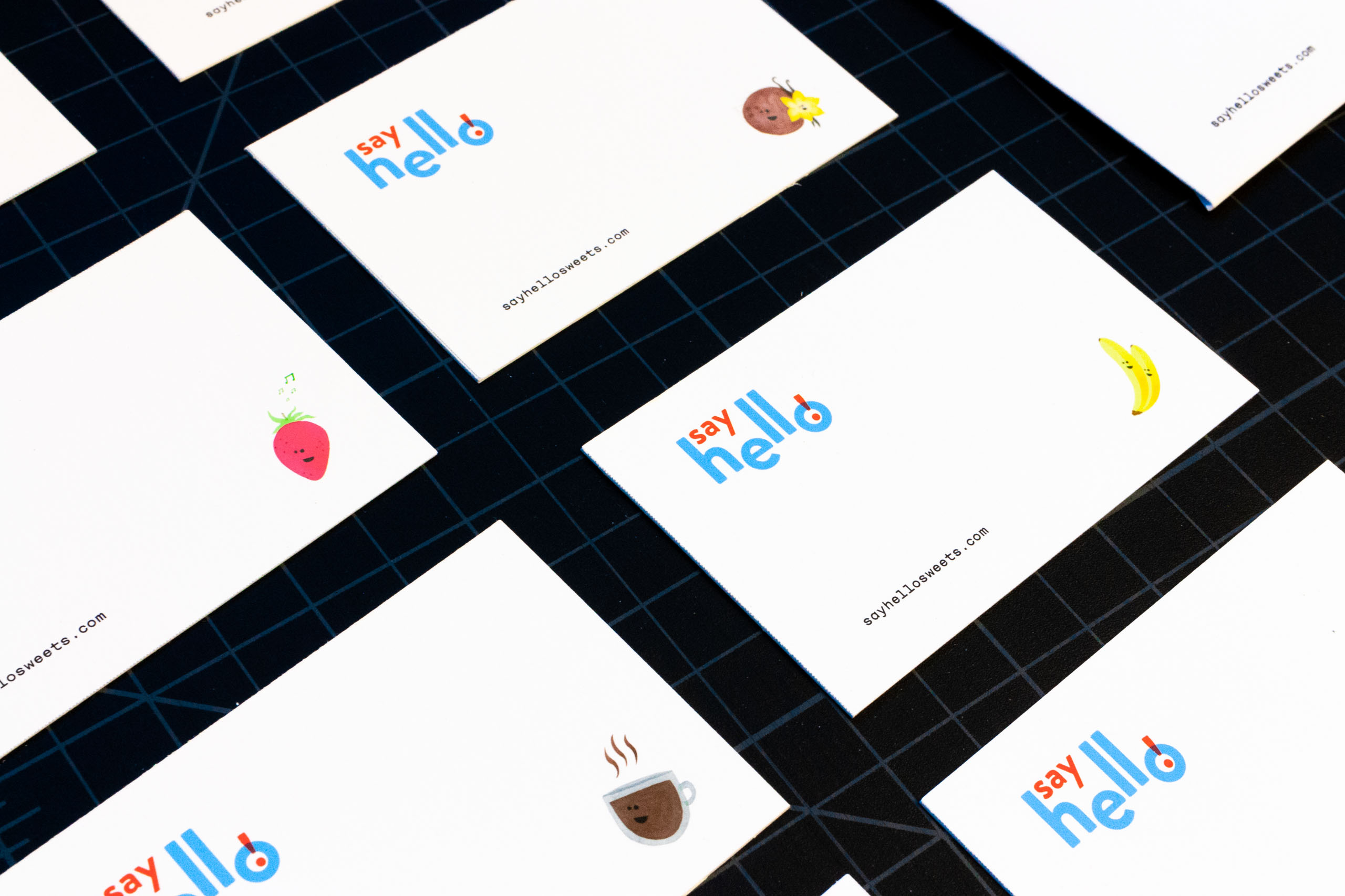 Set of business cards with strawberry, coconut, vanilla, banana, and coffee cup illustration — by Yagnyuk.