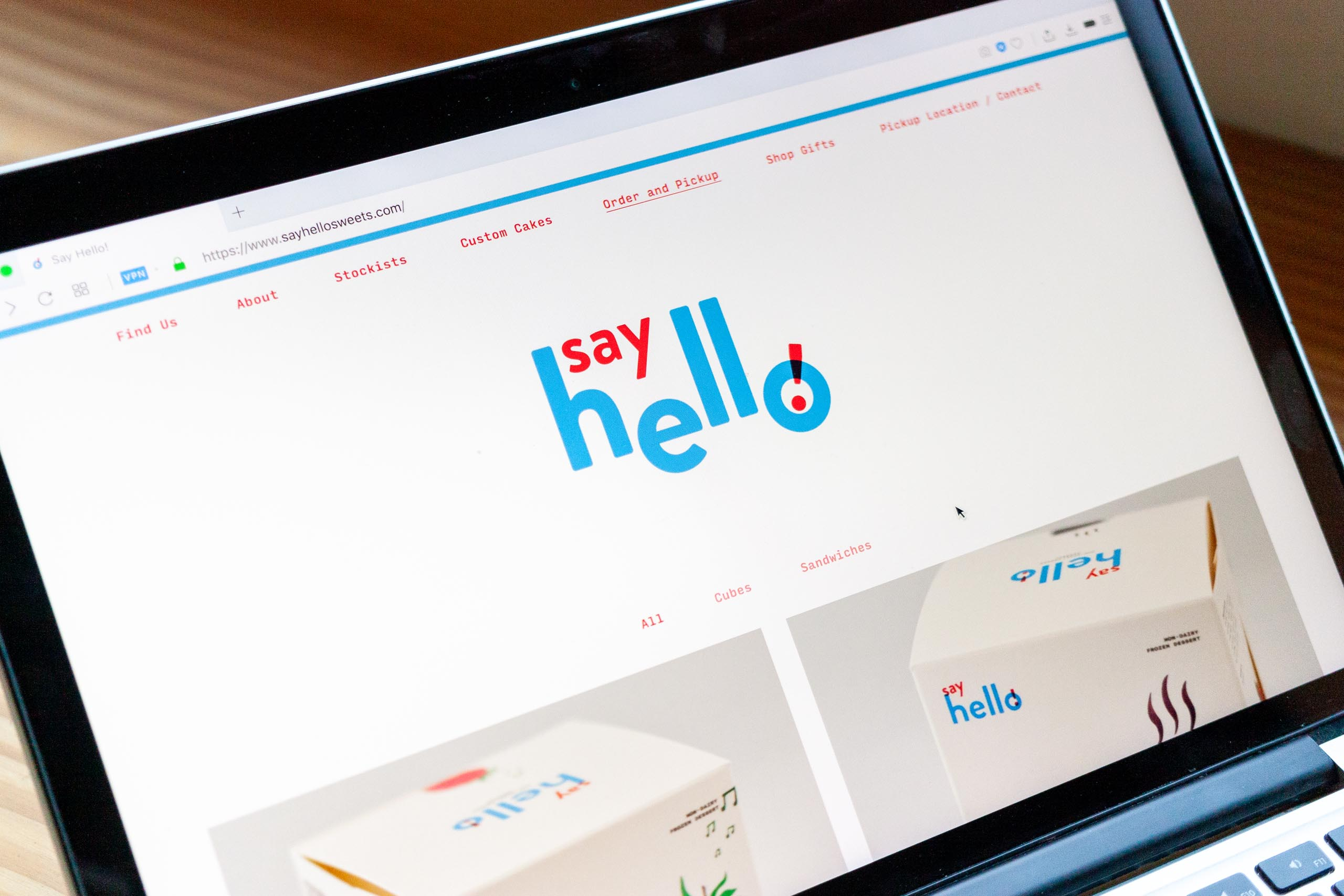 Say Hello homepage photographed on a laptop screen — by Yagnyuk.