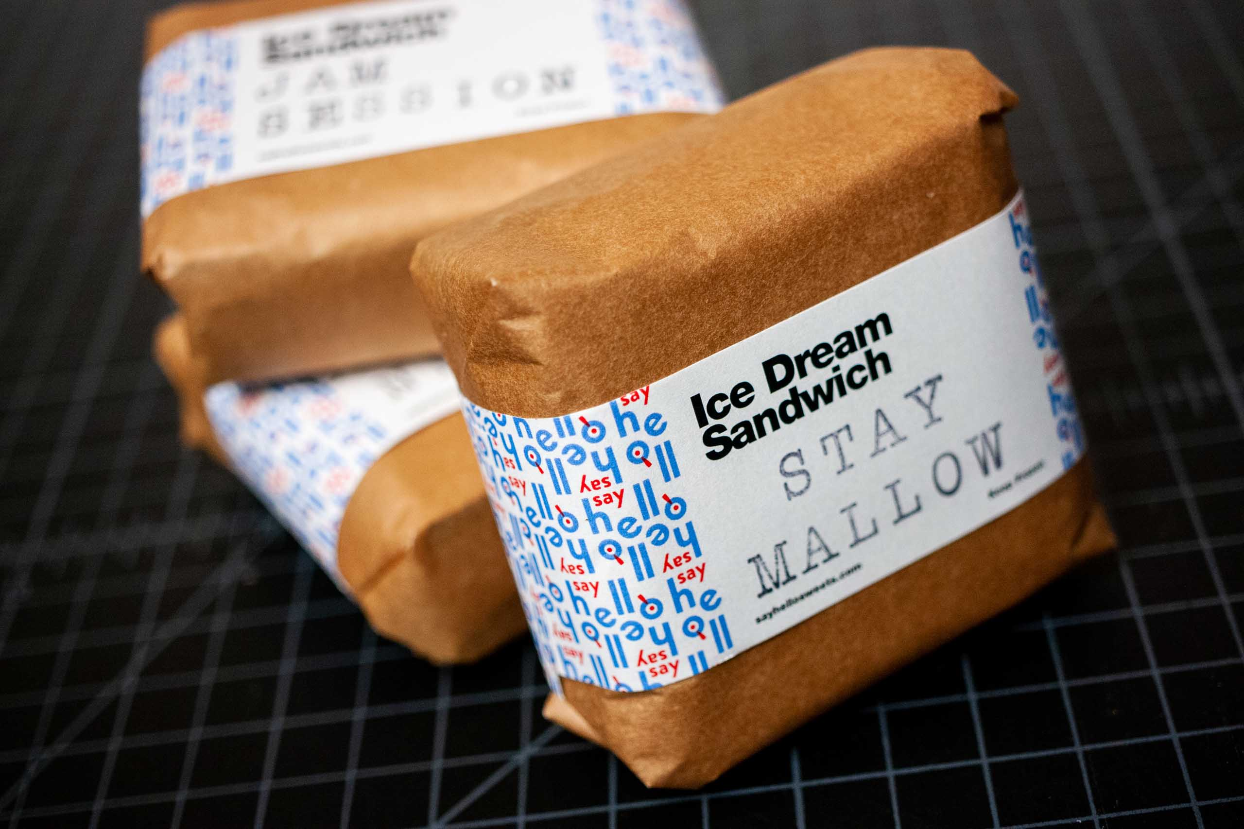 Tree ice cream sandwiches with label on, showcasing the warm brown craft paper wrapper — by Dima Yagnyuk.