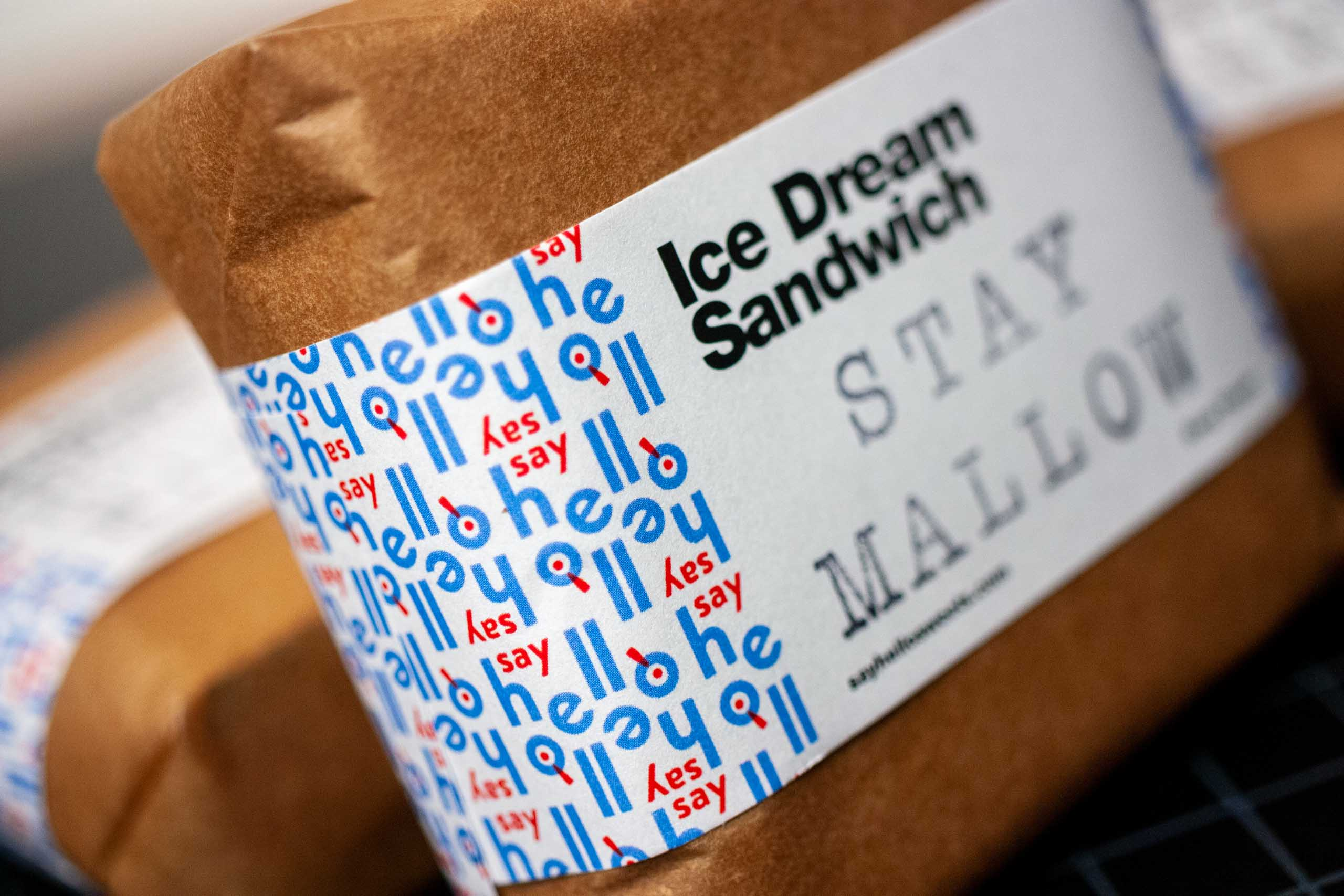 """Macro shot showing repeating """"Say Hello"""" brand pattern used for ice cream sandwich wrappers — by Dima."""