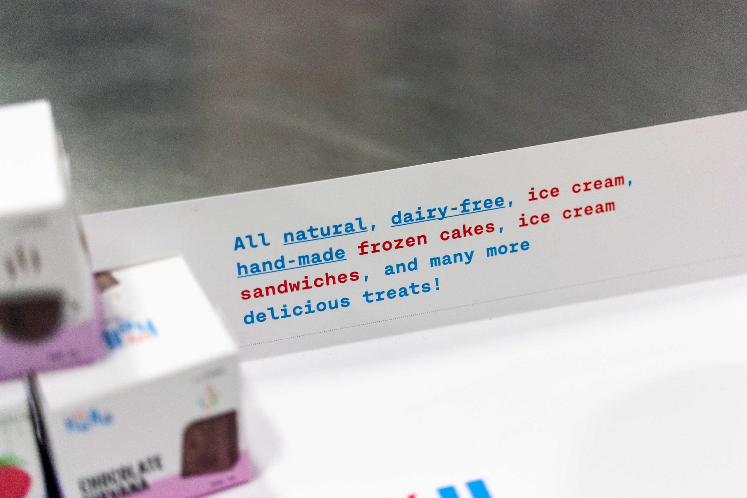 Close up of Say Hello sweets brand manifesto, printed on the tray in vibrant red and blue colors — by Dima Yagnyuk.