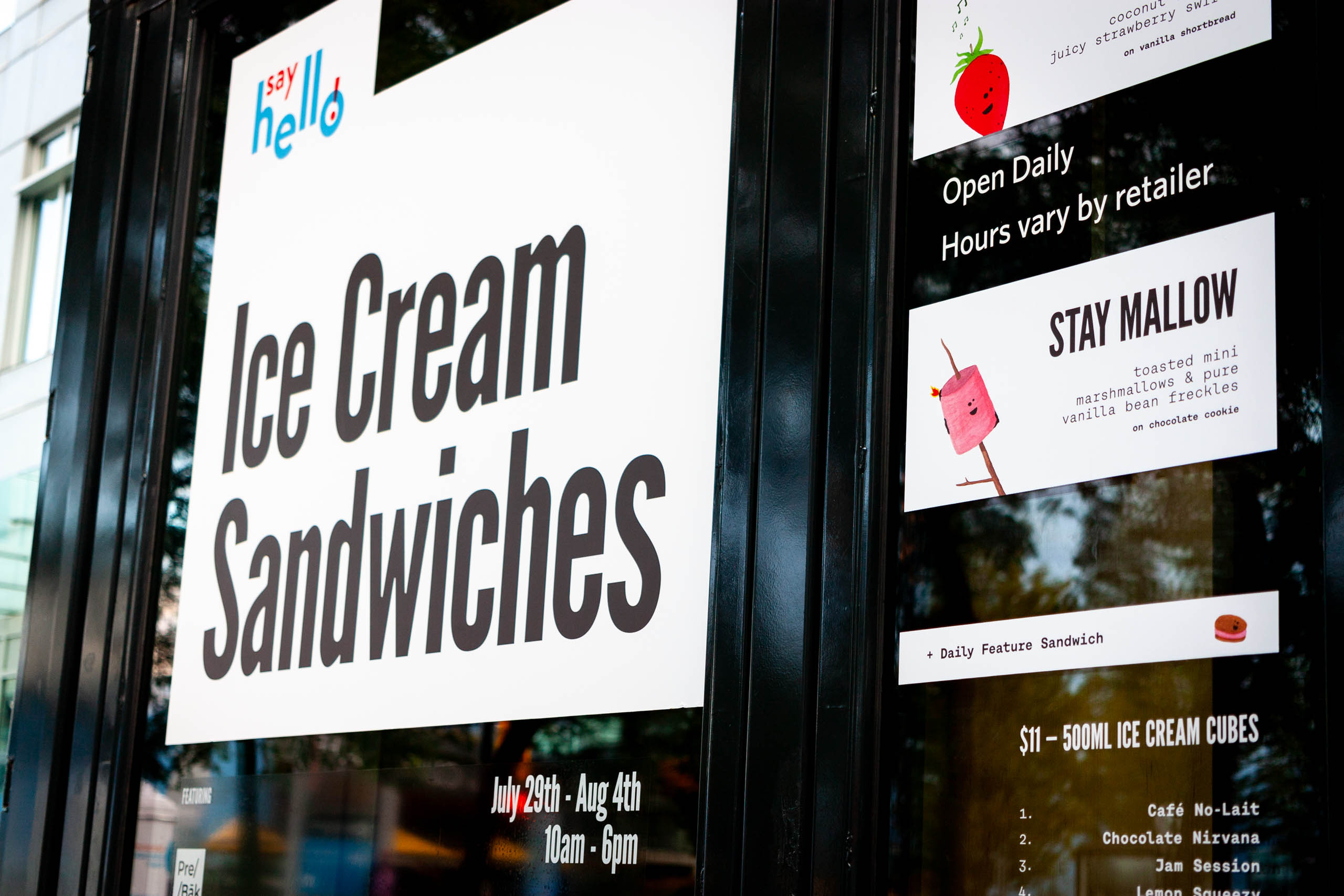 Say Hello Store at the Vancouver Convention center, featuring prominent window design advertising the featured Ice Cream Sandwiches — by Yagnyuk.