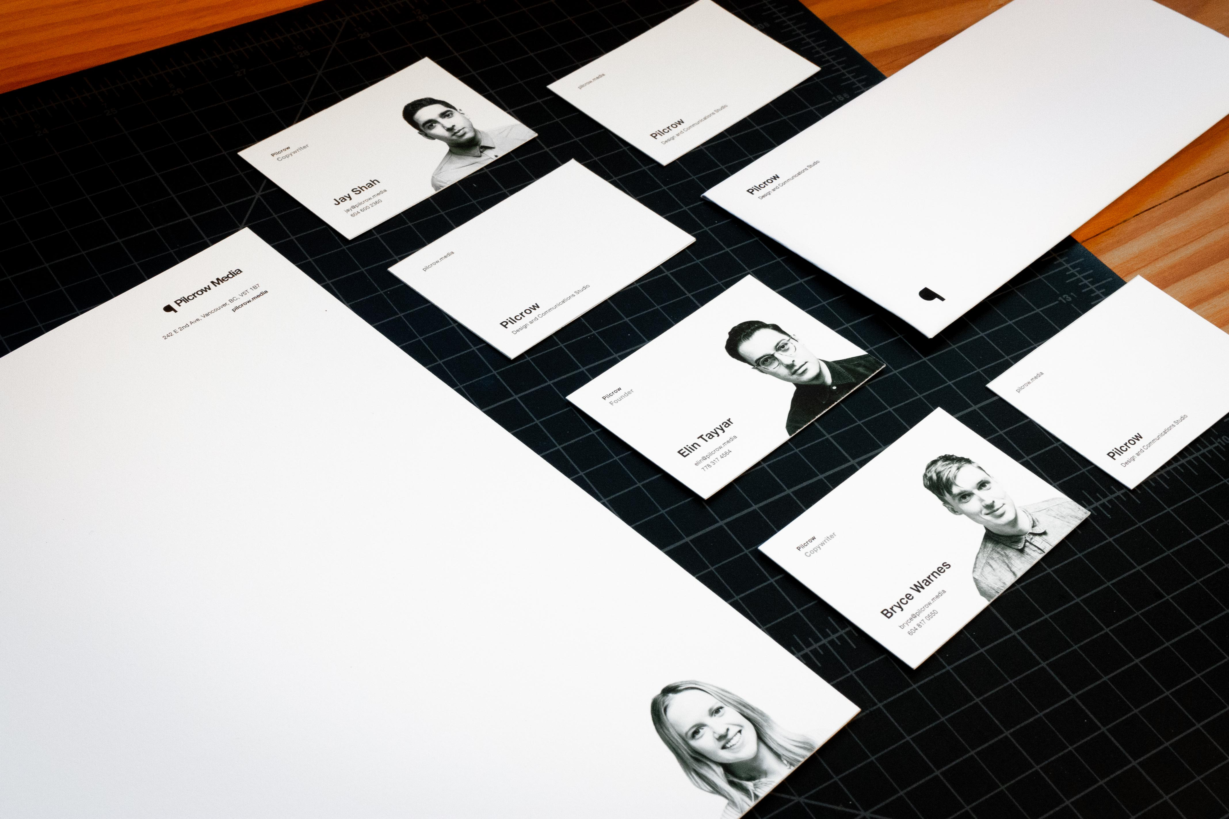 Pilcrow Media envelopes and various personalized letterheads and business cards for each team member featuring their portrait photography — by Yagnyuk.