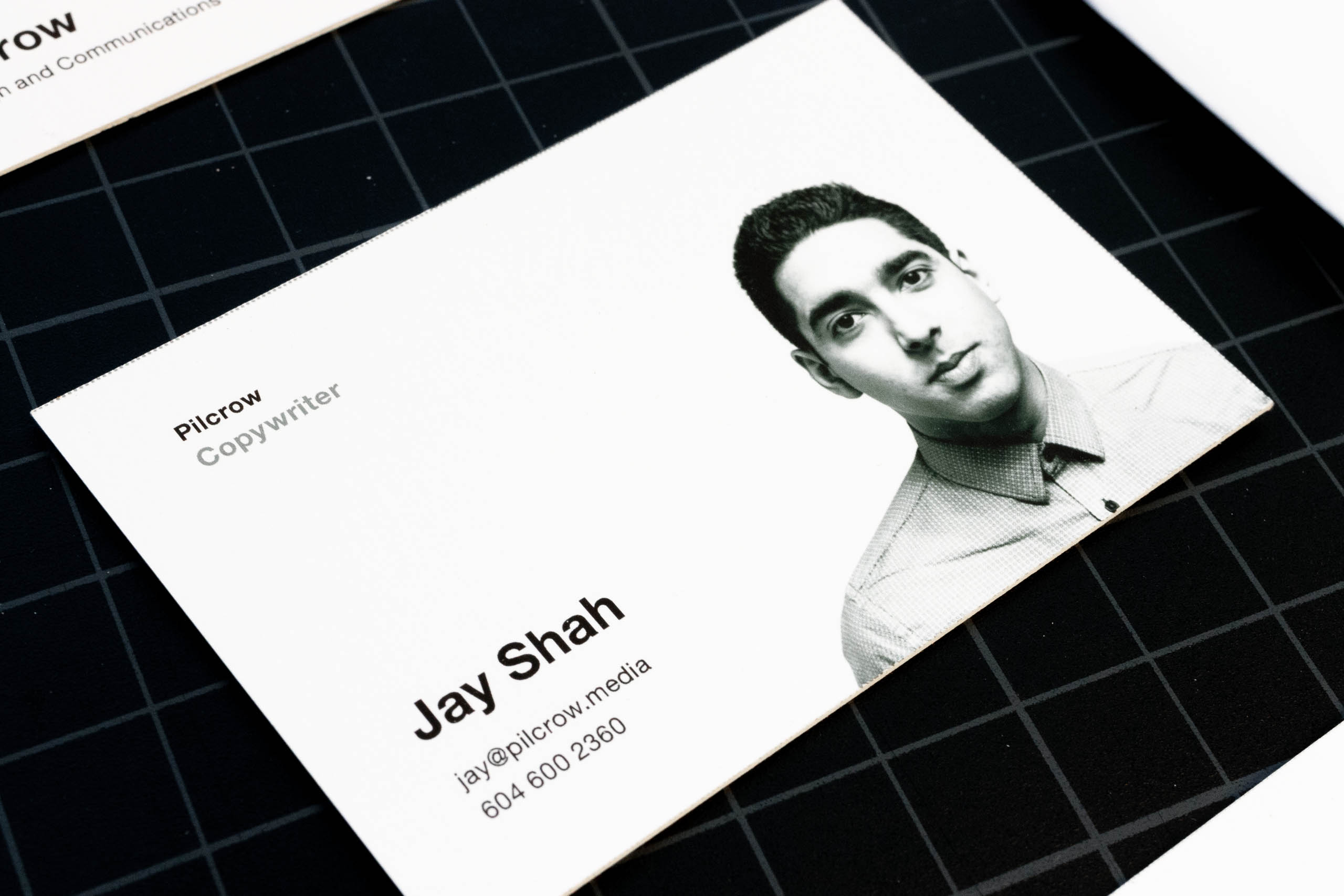 Close up of the content side of Pilcrow Media copywriter business card featuring black and white portrait photography — by Yagnyuk.