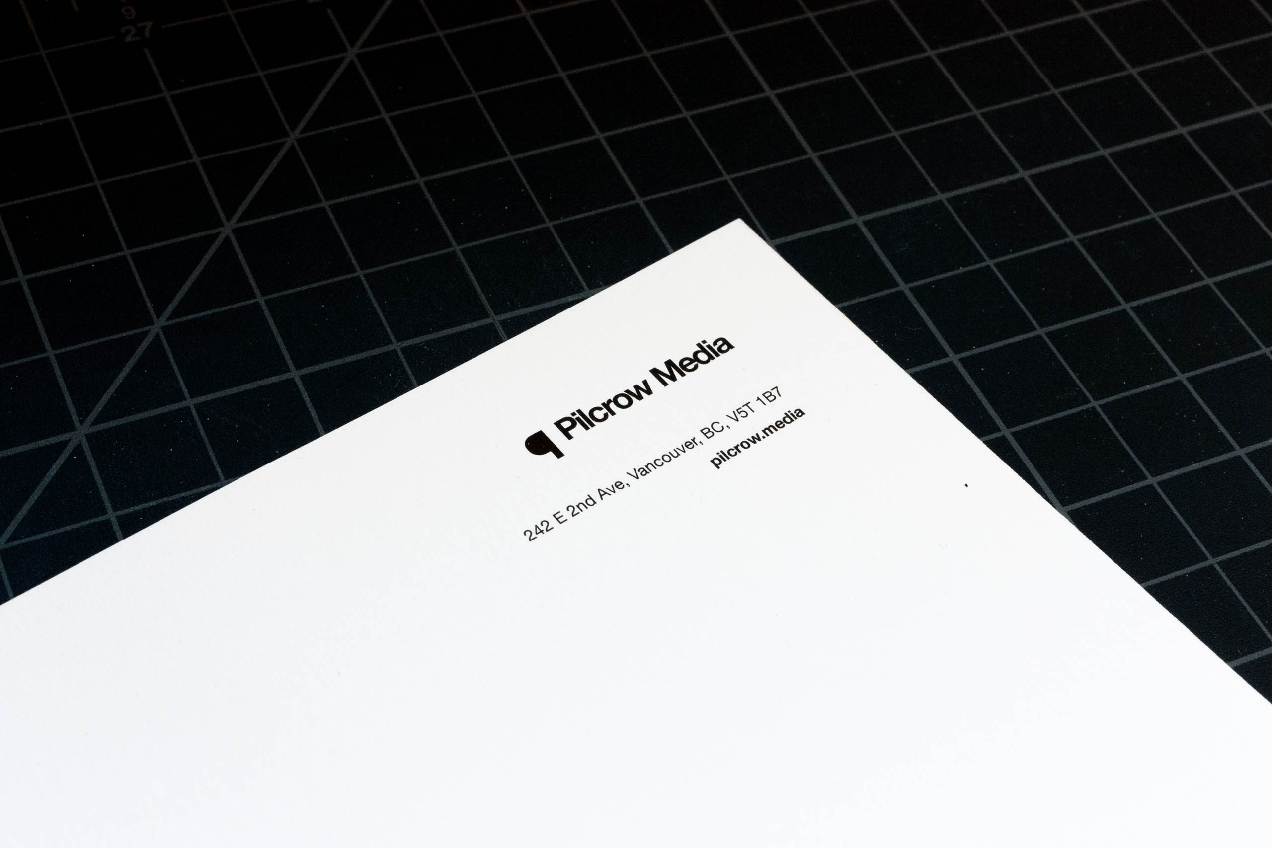 Top right corner of Pilcrow Media letterhead showing studio logo and contact information — by Yagnyuk.