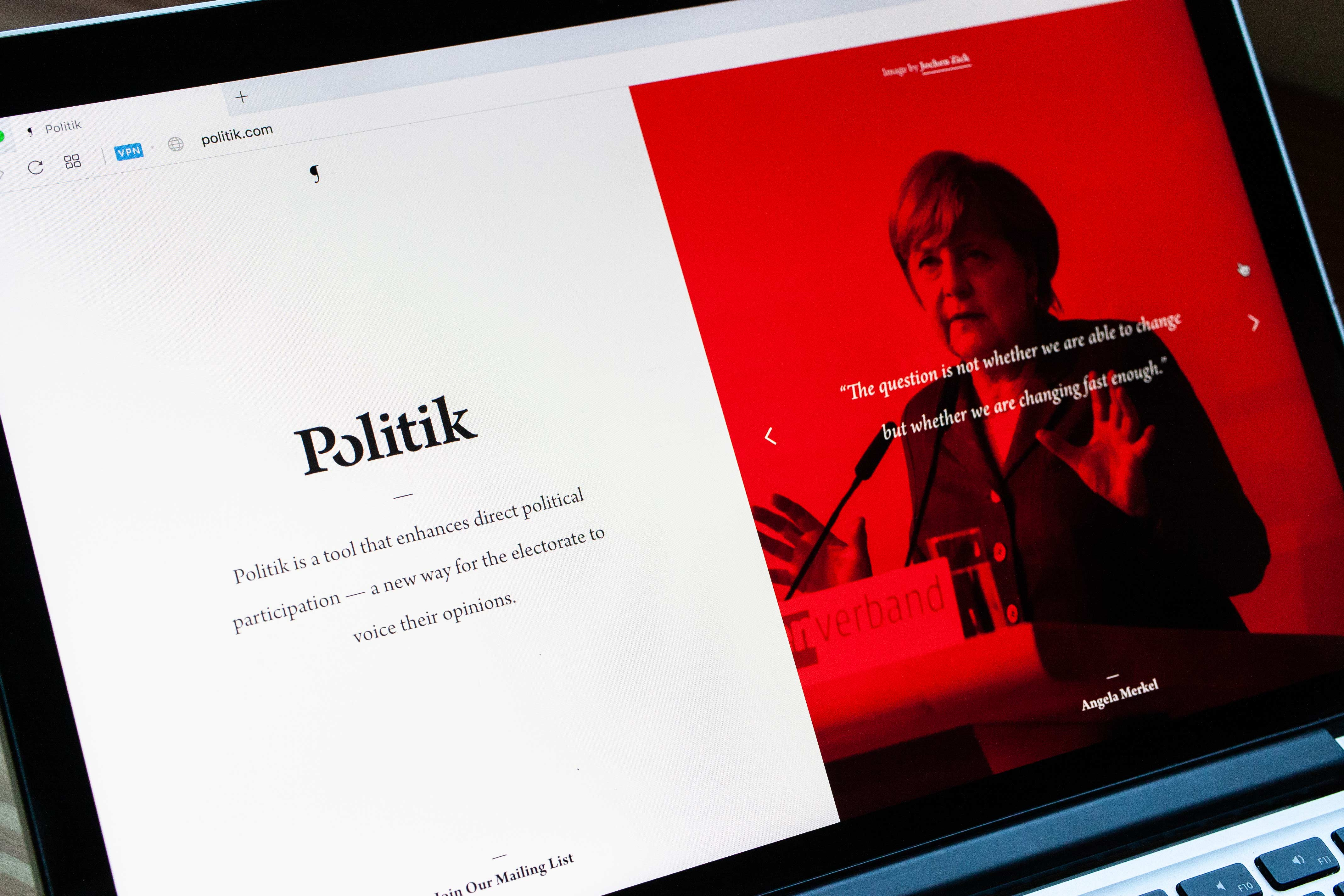 Neon Red Politik page featuring photography and quote from Angela Merkel — by Yagnyuk.