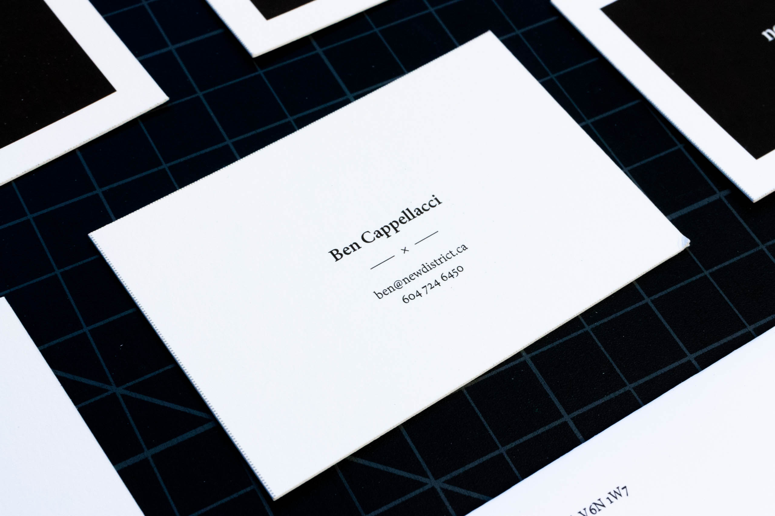 Business card showing details of New District founder — by Yagnyuk.