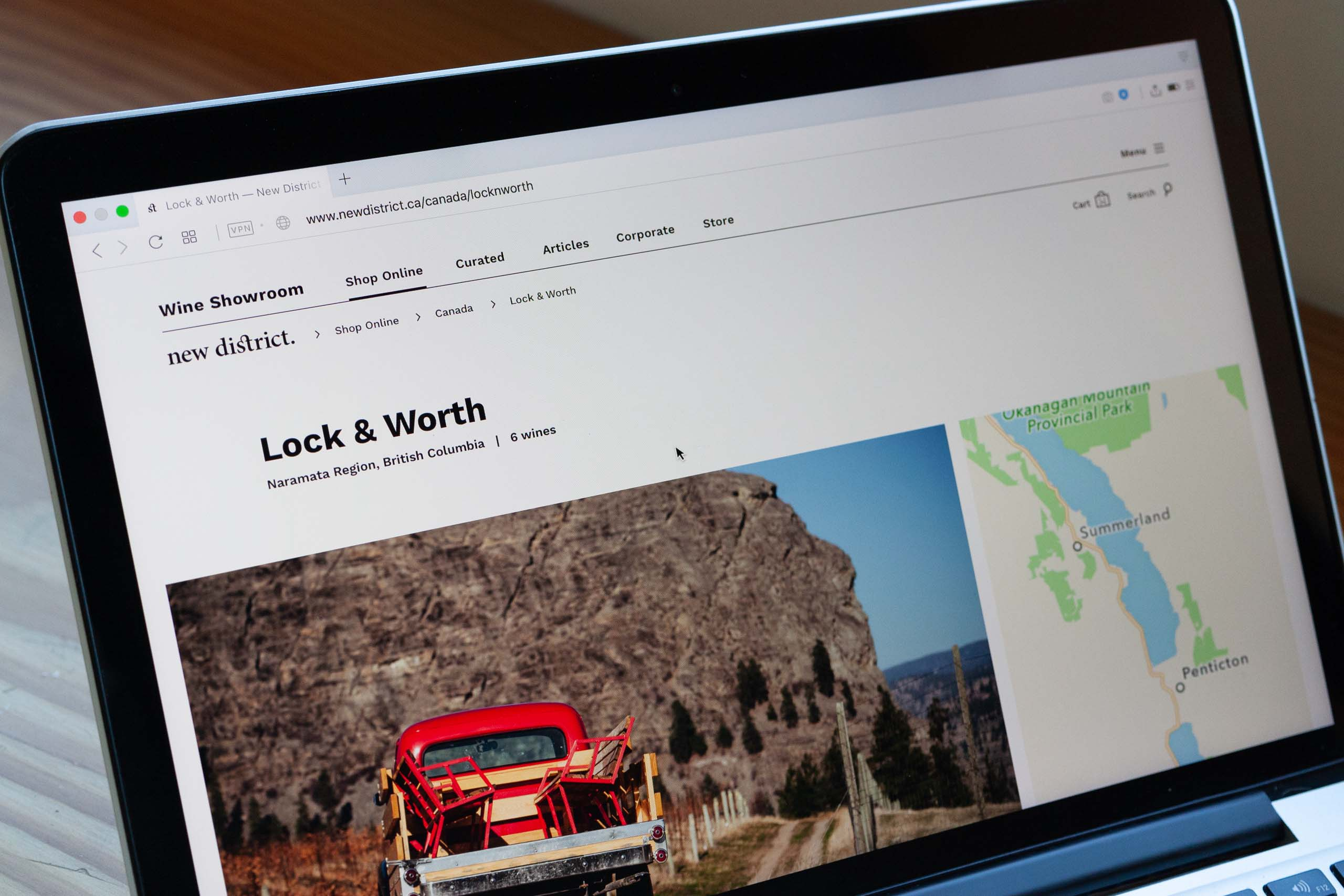 Close up of New District's winery page template for Lock & Worth Winery, showcasing winery photo and map to — by Yagnyuk.