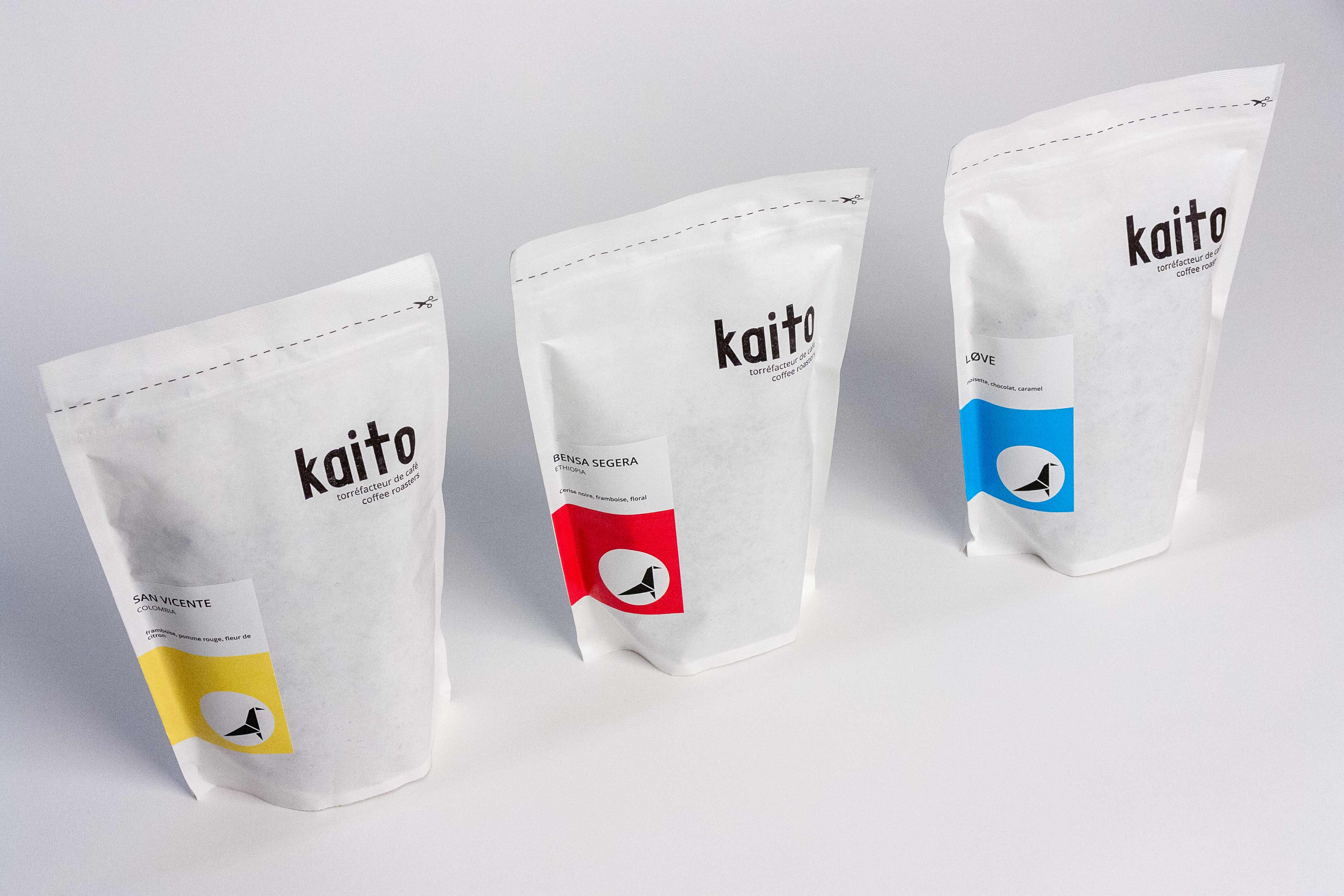 Kaito Coffee three coffee bags with printed logo and yellow, red, and blue labels applied to corresponding flavours — Yagnyuk.