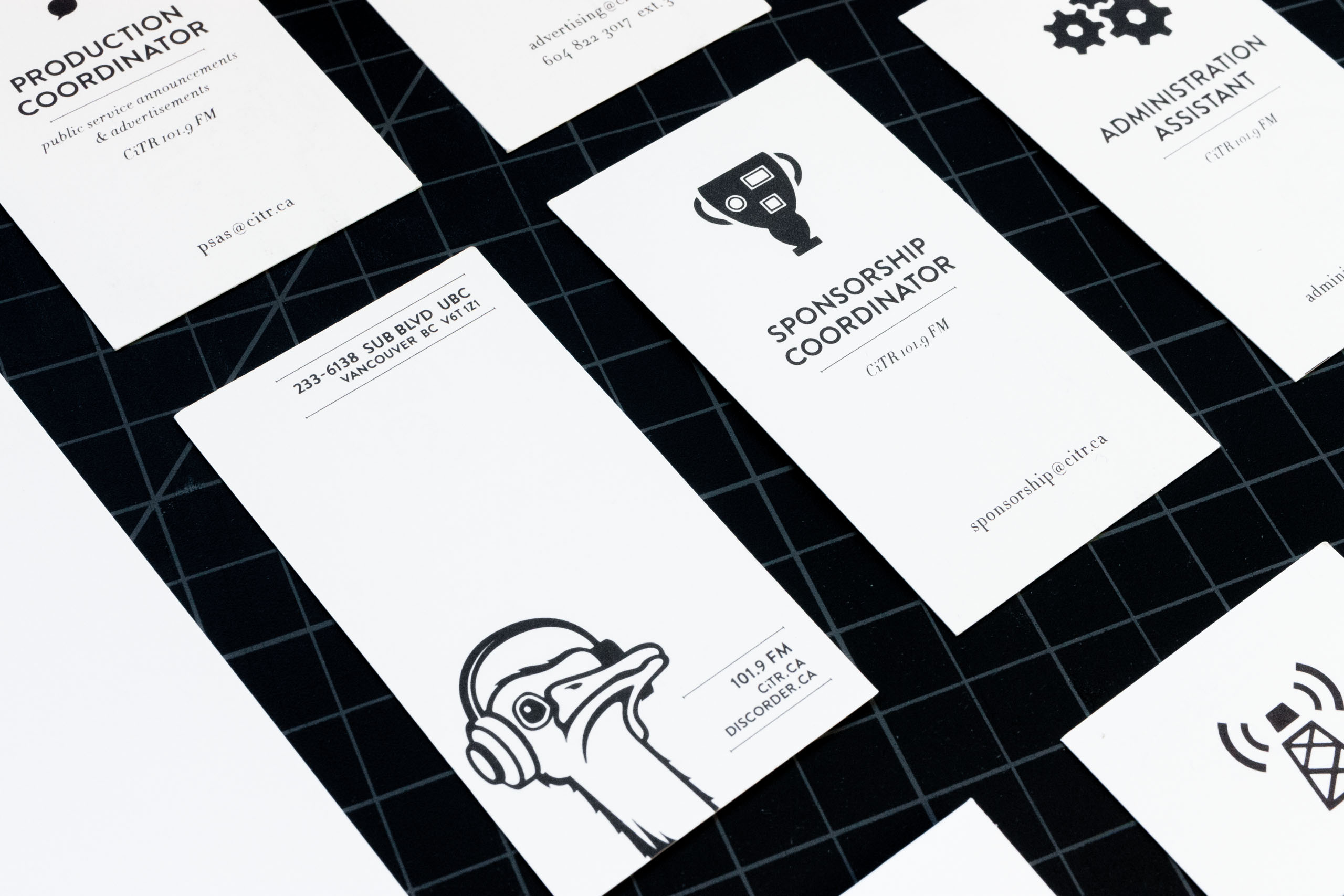 Close up of Sponsorship coordinator business cards for CiTR Radio featuring an illustration of a trophy with badges on it — by Yagnyuk.