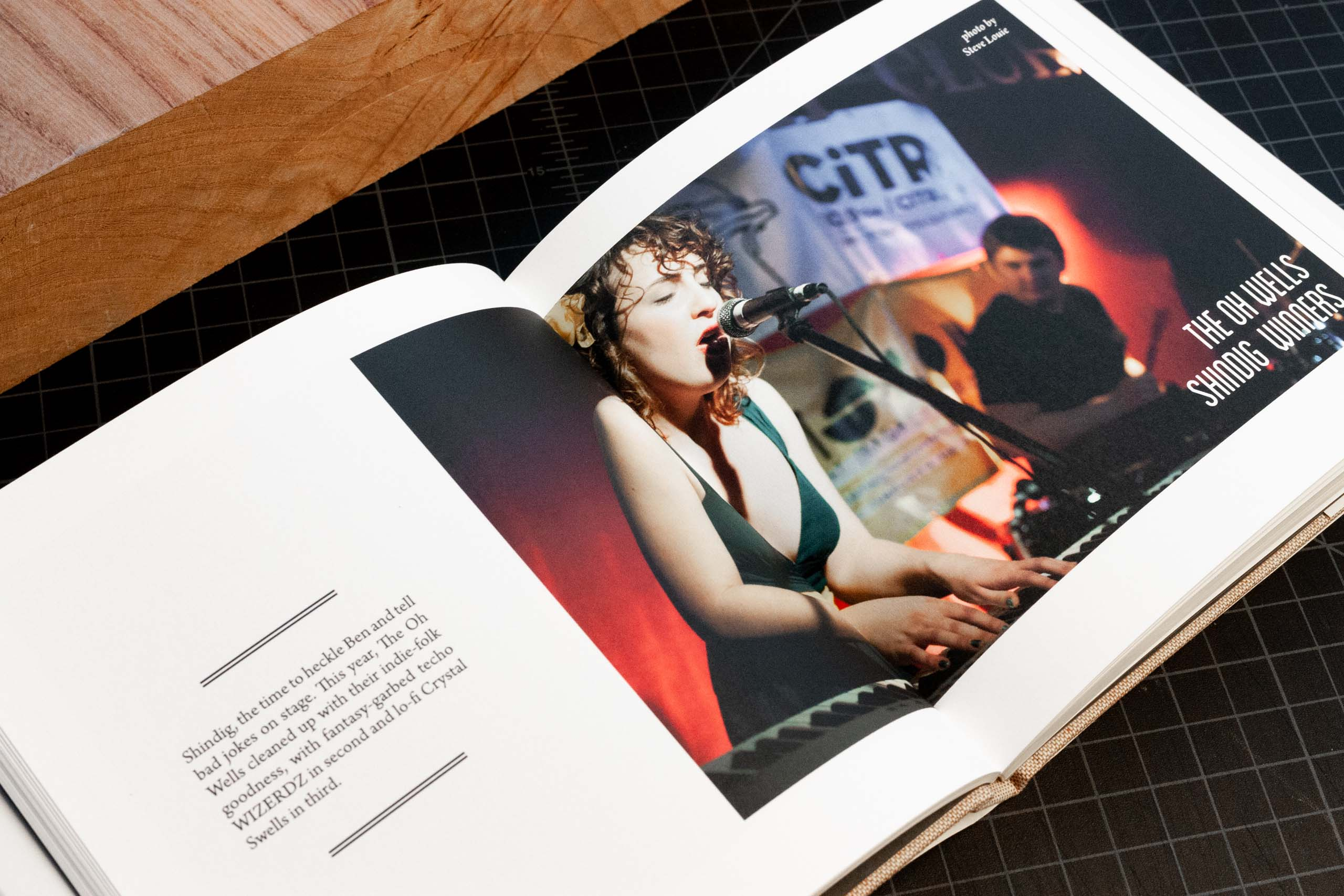 Annual Report for CiTR radio featuring a photo of Sarah Jickling the lead singer of 'The Oh Wells' playing at the Shindig competition — by Yagnyuk.
