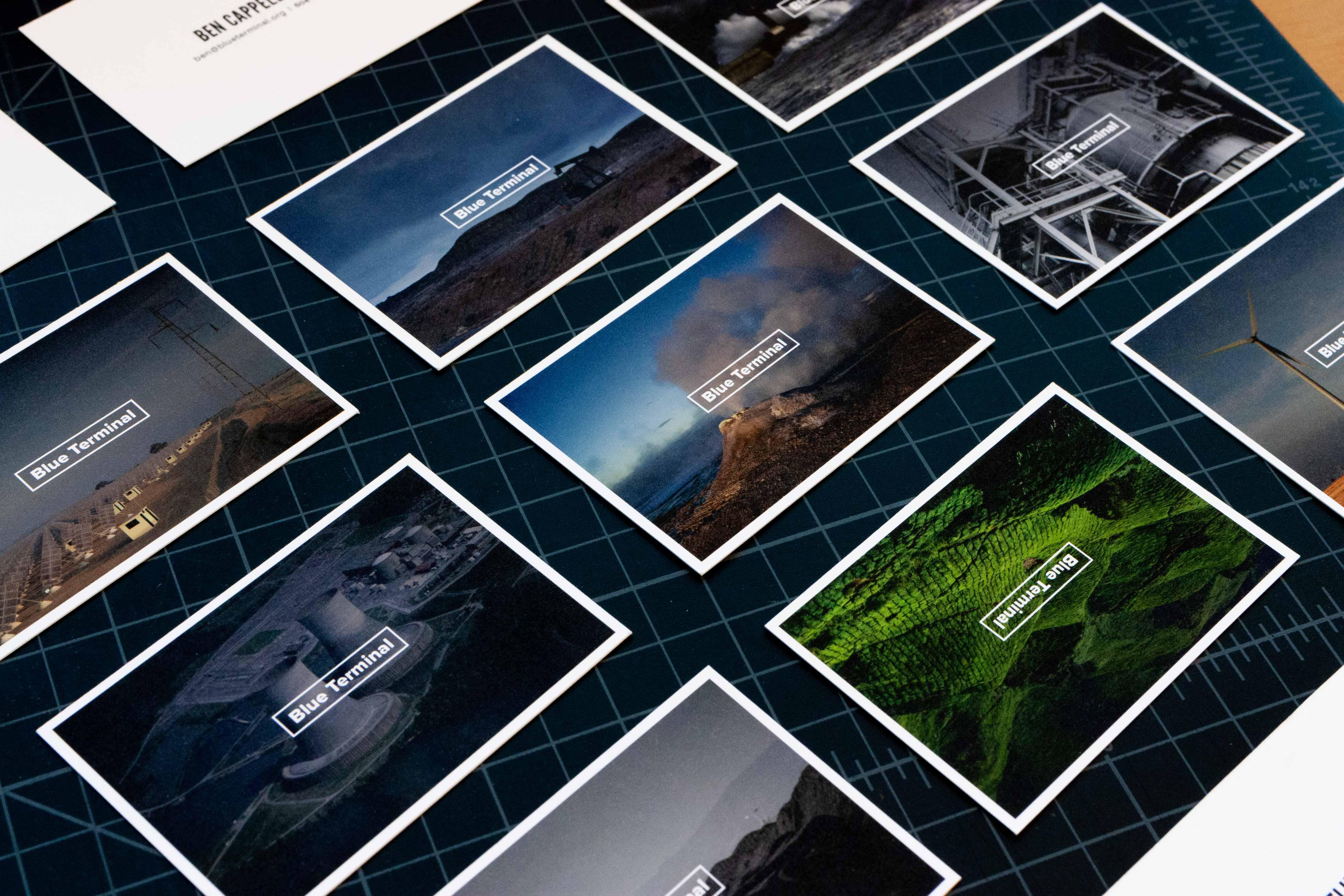 Blue Terminal business cards featuring various images of energy related scenes including oil refining, nuclear power, solar farms, wind farms and geothermal — by Yagnyuk.
