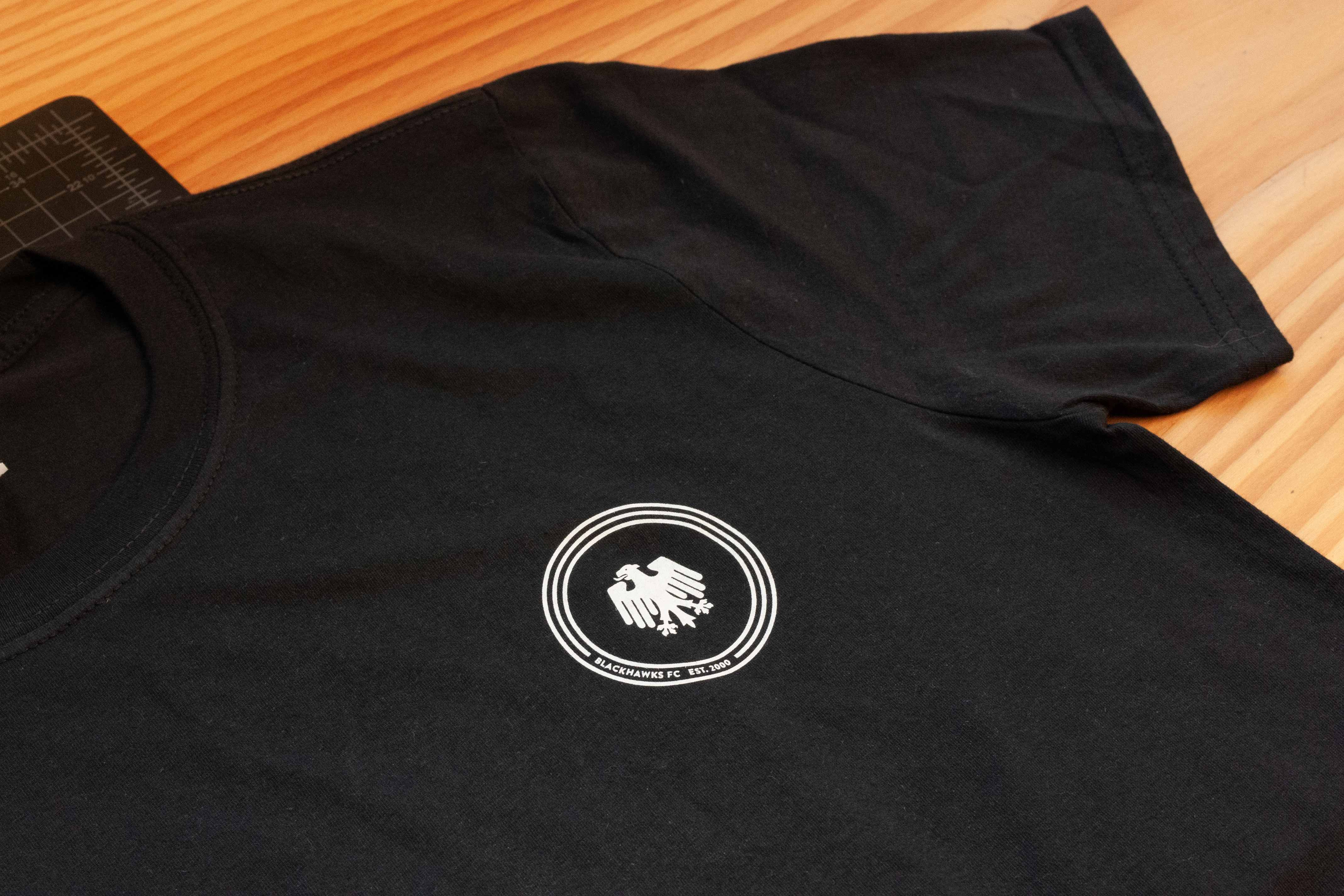 Blackhawks FC logo on black heather shirt — by Yagnyuk.