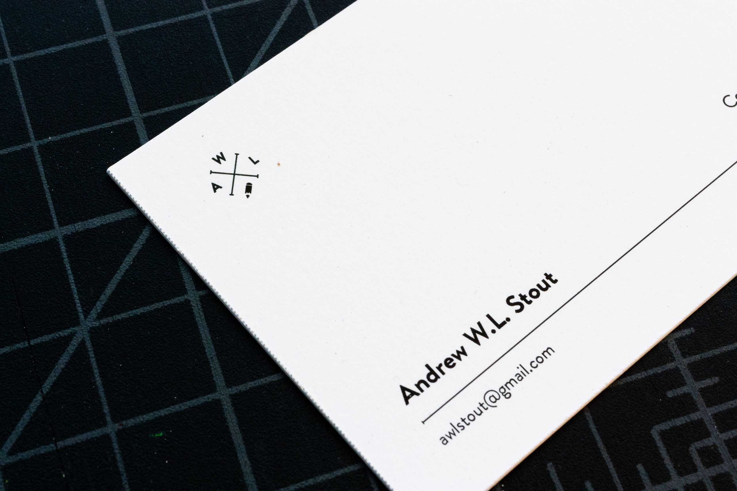 Close up of AWL consulting business card with contact info — by Yagnyuk.