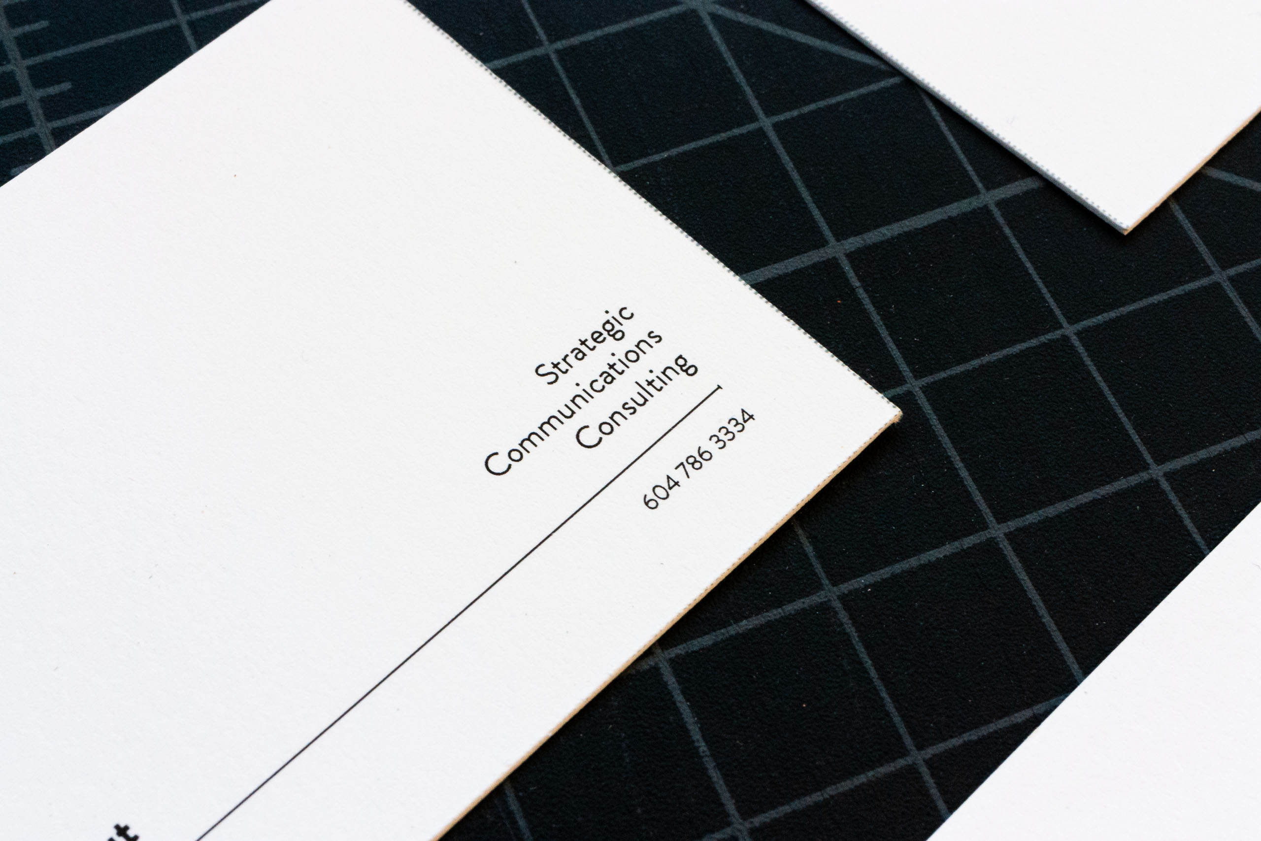 Close up of AWL consulting business card with general brand tag line — by Yagnyuk.