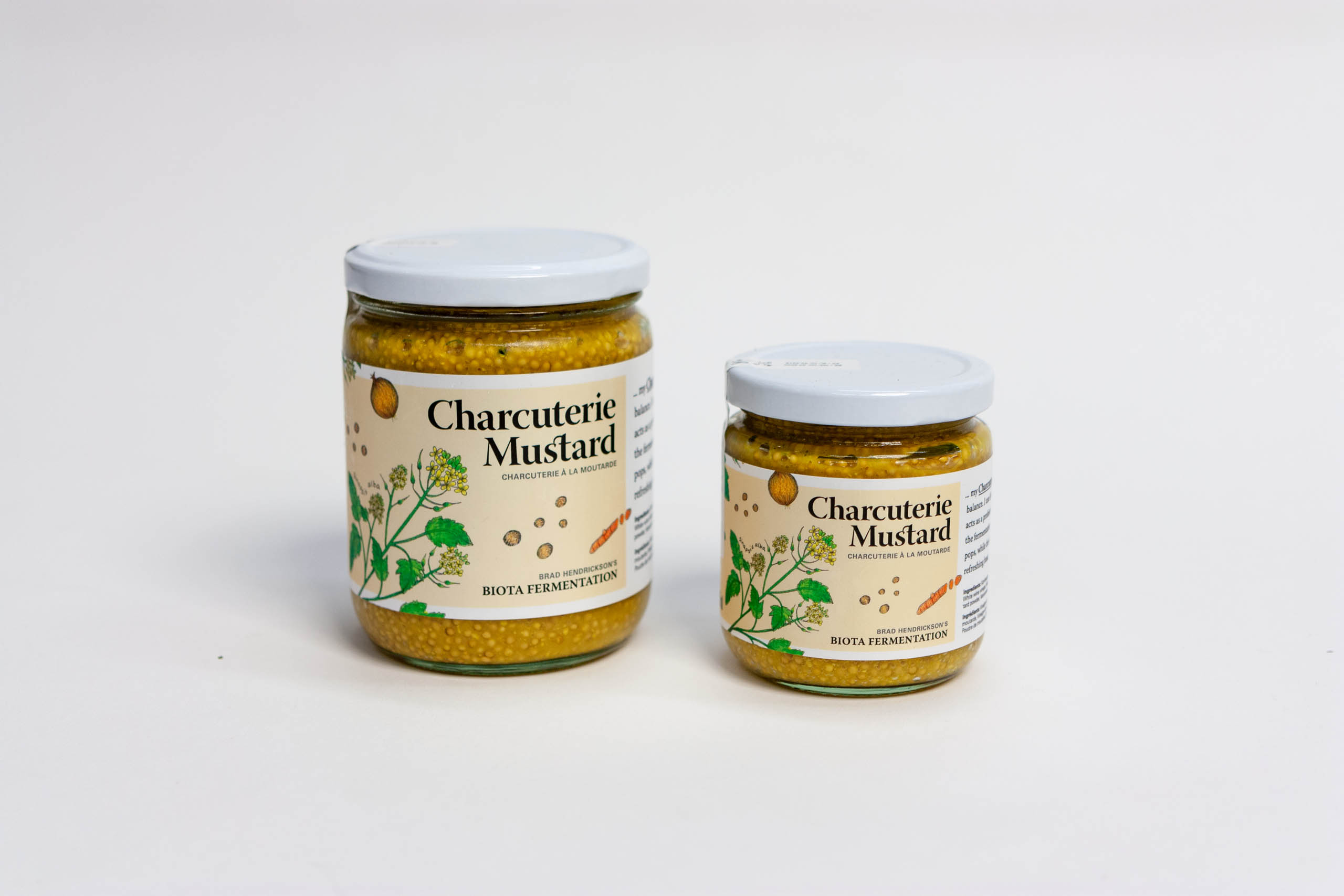 Charcuterie Mustard Jars with mustard plant illustration on a light brown-yellow background — by Yagnyuk.