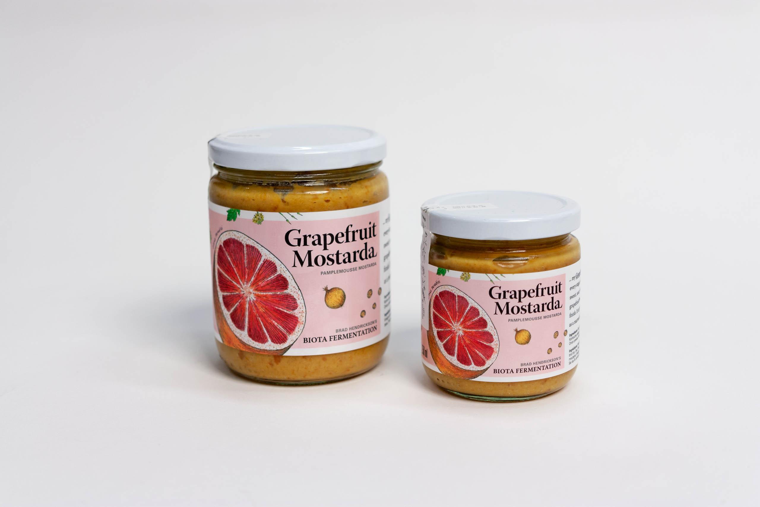 Grapefruit Mostarda Jars with grapefruit illustrations on a light pink background — by Yagnyuk.