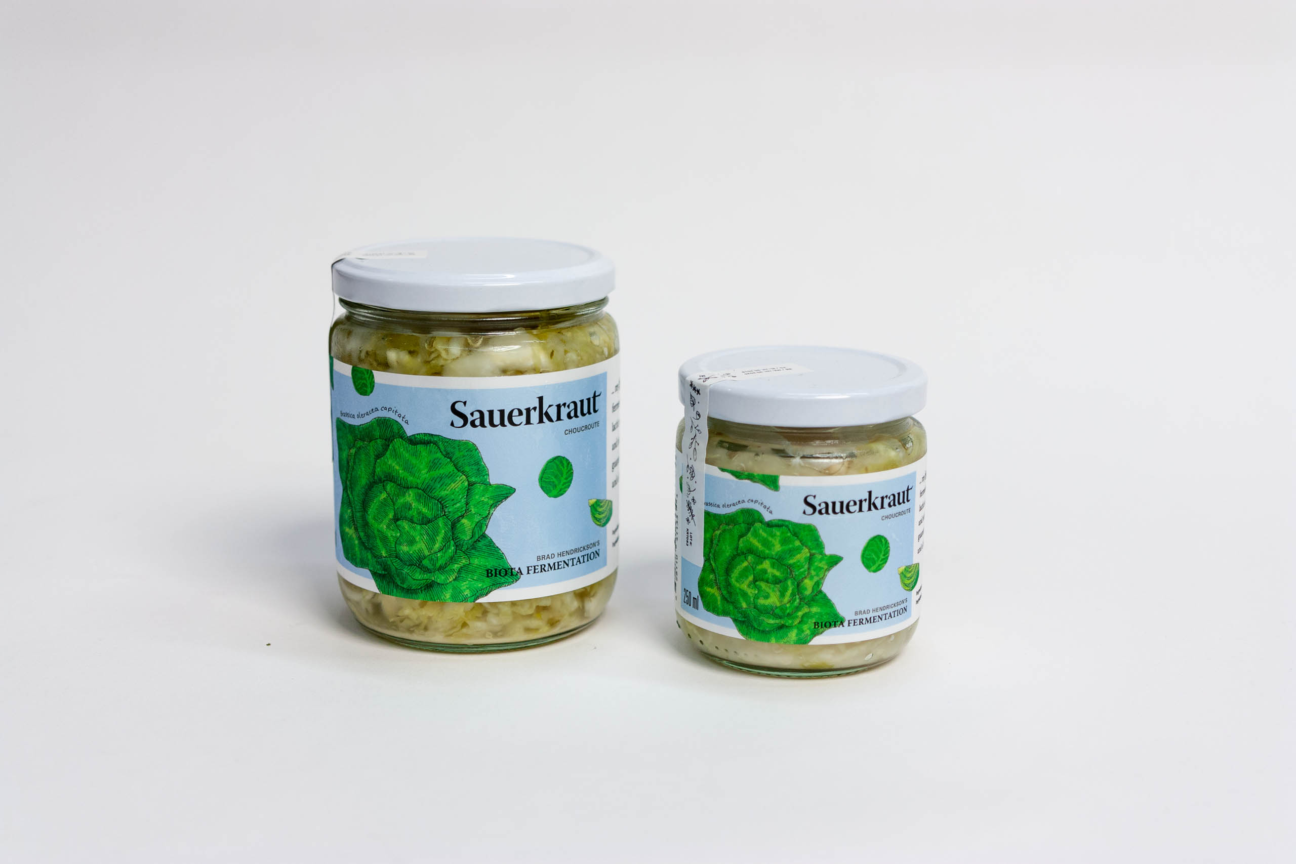 Saurkrauit Jars with vibrant green cabbage illustration on a light blue background — by Yagnyuk.