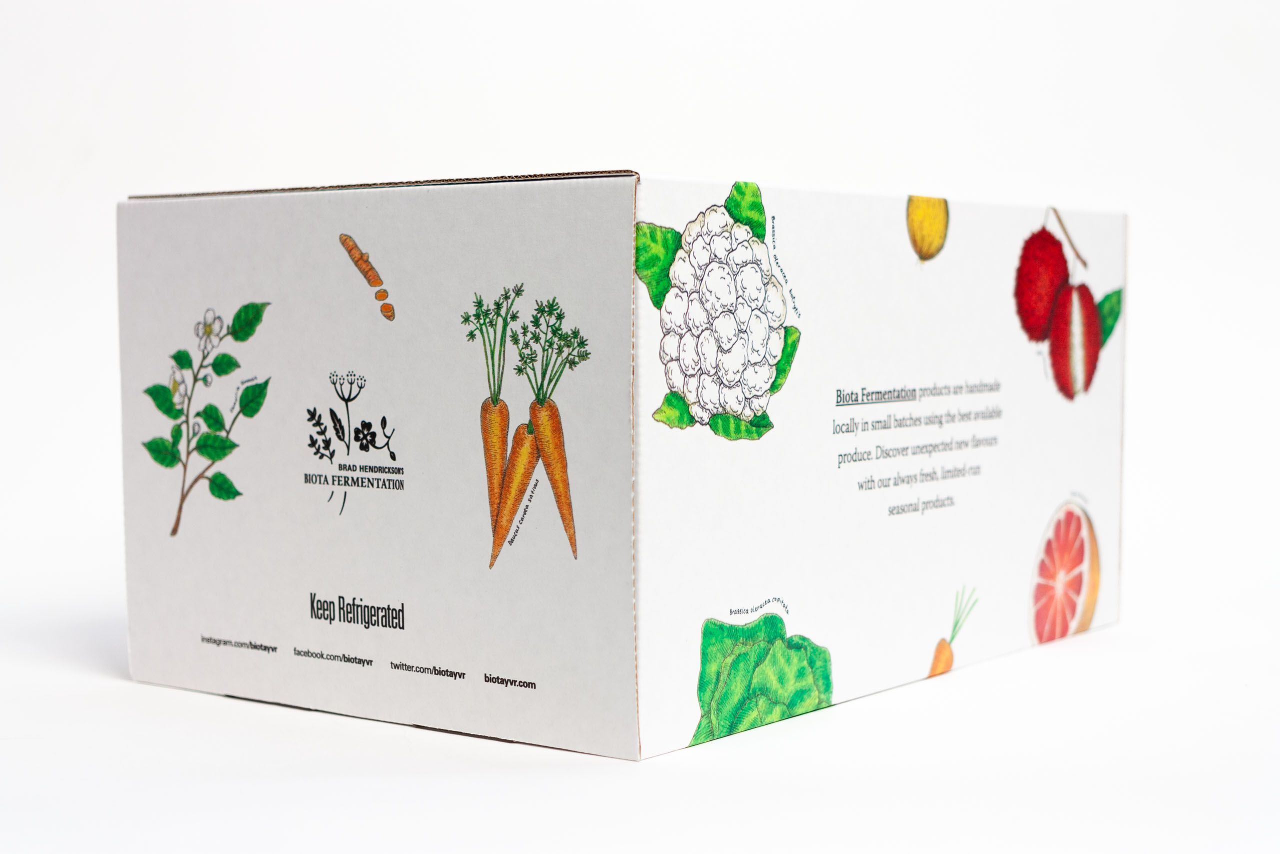Alternative side of BIota Giftbox showcasing the side panel design of bouquet logo surrounded by carrot and tea illustration — by Yagnyuk.