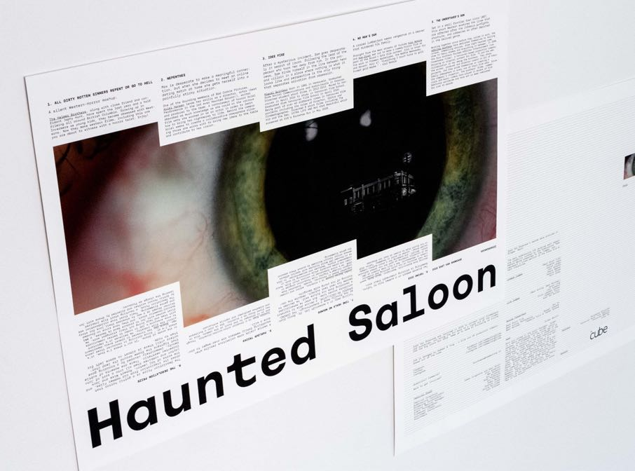 Poster for Haunted Saloon Film Festival featuring a close up of an eye with a reflection of an old house in the retina — by Dima Yagnyuk.