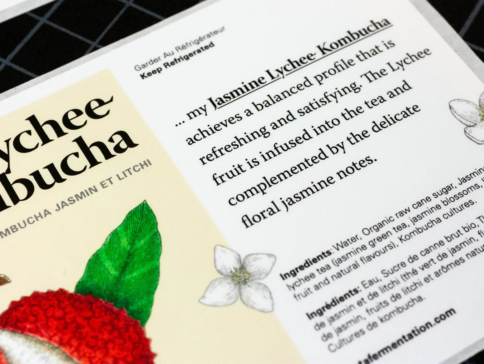 Close up details of custom product description embedded into label for Jasmine Lychee Kombucha — by Yagnyuk.