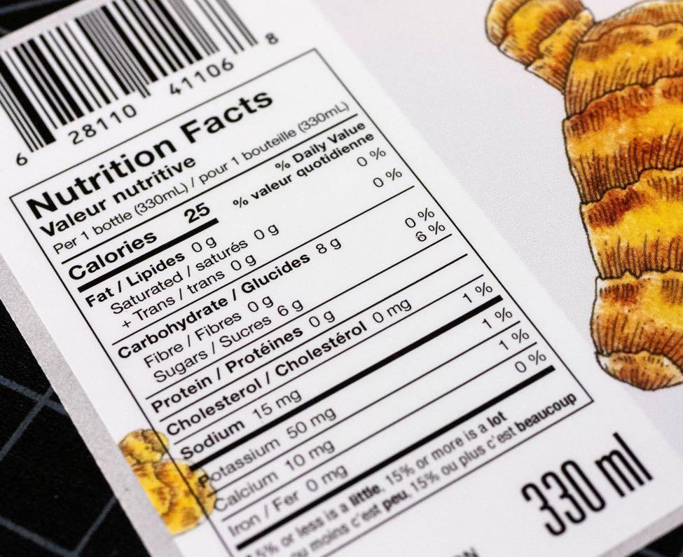 Close up details of Biota Fermentation Ginger Kombucha Nutritional Facts table showing close up details of the nutrition information and the embedded illustration by Jessica Fraser — Dima Yagnyuk.