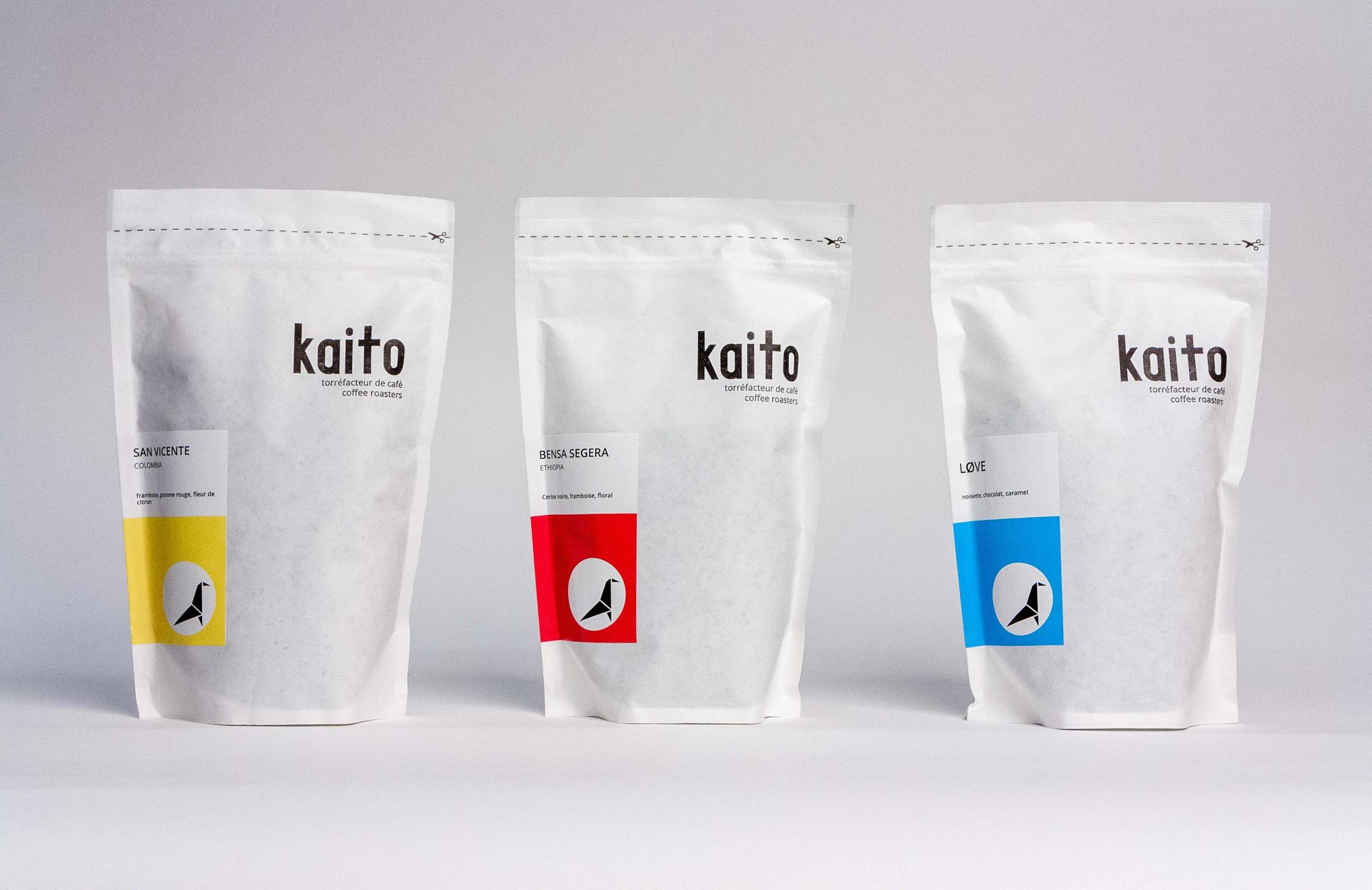 Kaito coffee logo applied to packaging in red, yellow and blue components of the brand system — by Yagnyuk.