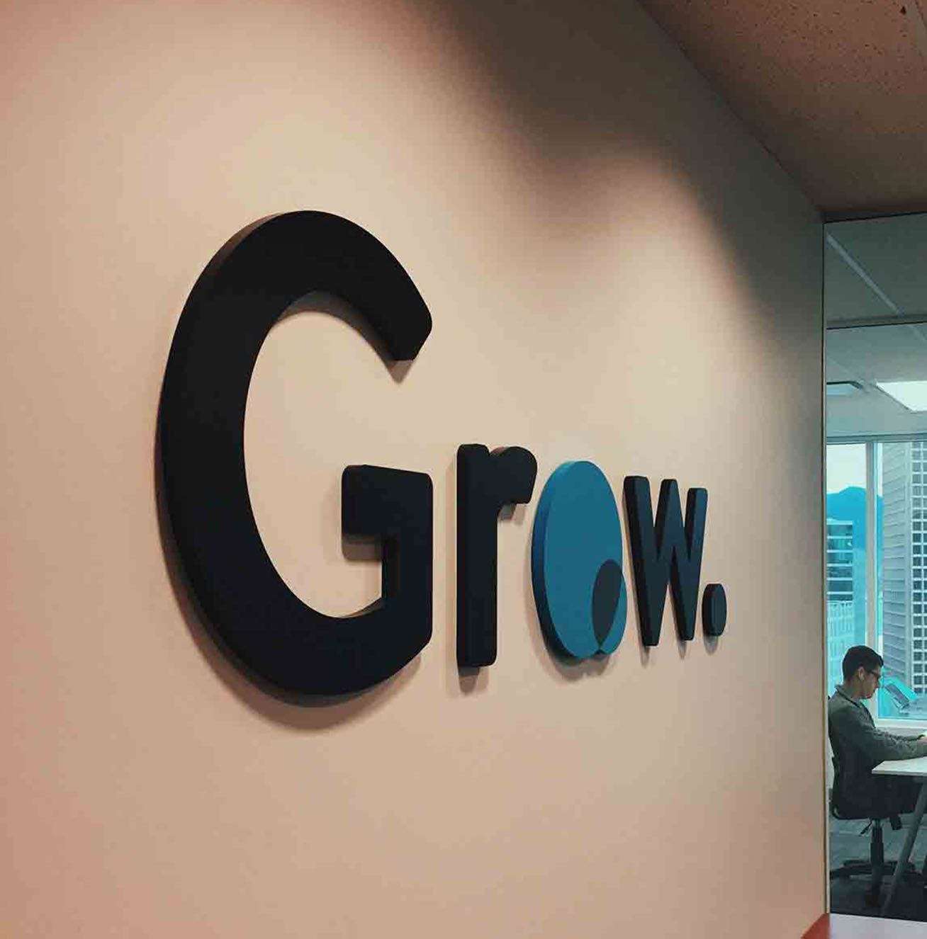 Grow Financial Technologies logo installed on an office wall.
