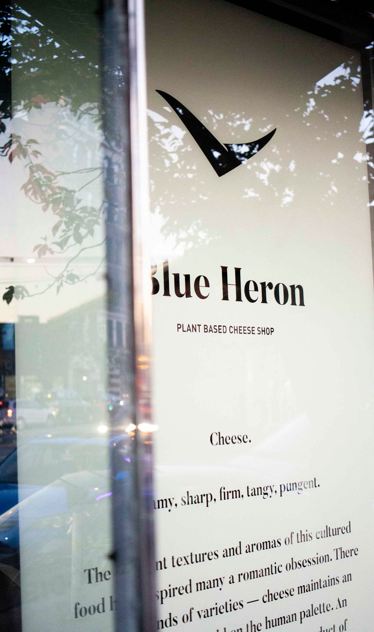 Blue Heron Cheese store window with handpainted logo and brand manifesto — by Dima Yagnyuk.