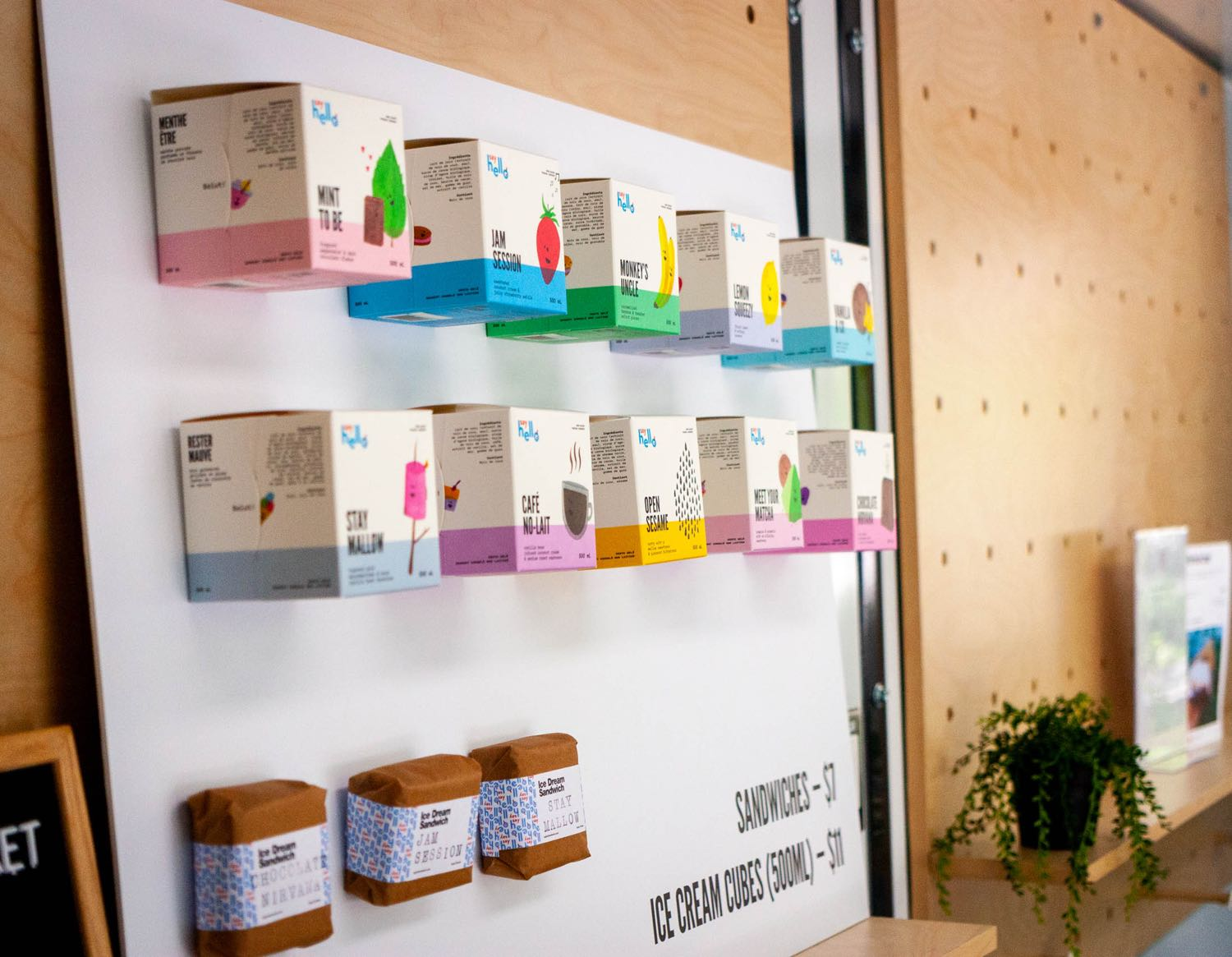 Say Hello Store Menu with physical cubes and sandwiches attached as display — by Dima Yagnyuk.