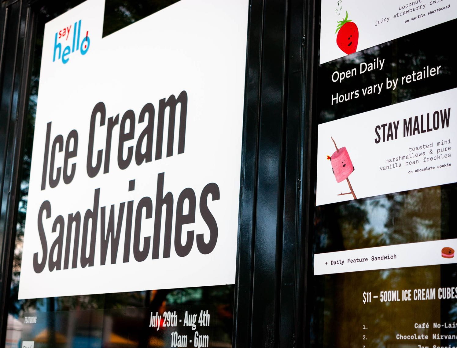 Close up of Say Hello Sweets Store windows advertising ice cream sandwiches — by Dima.