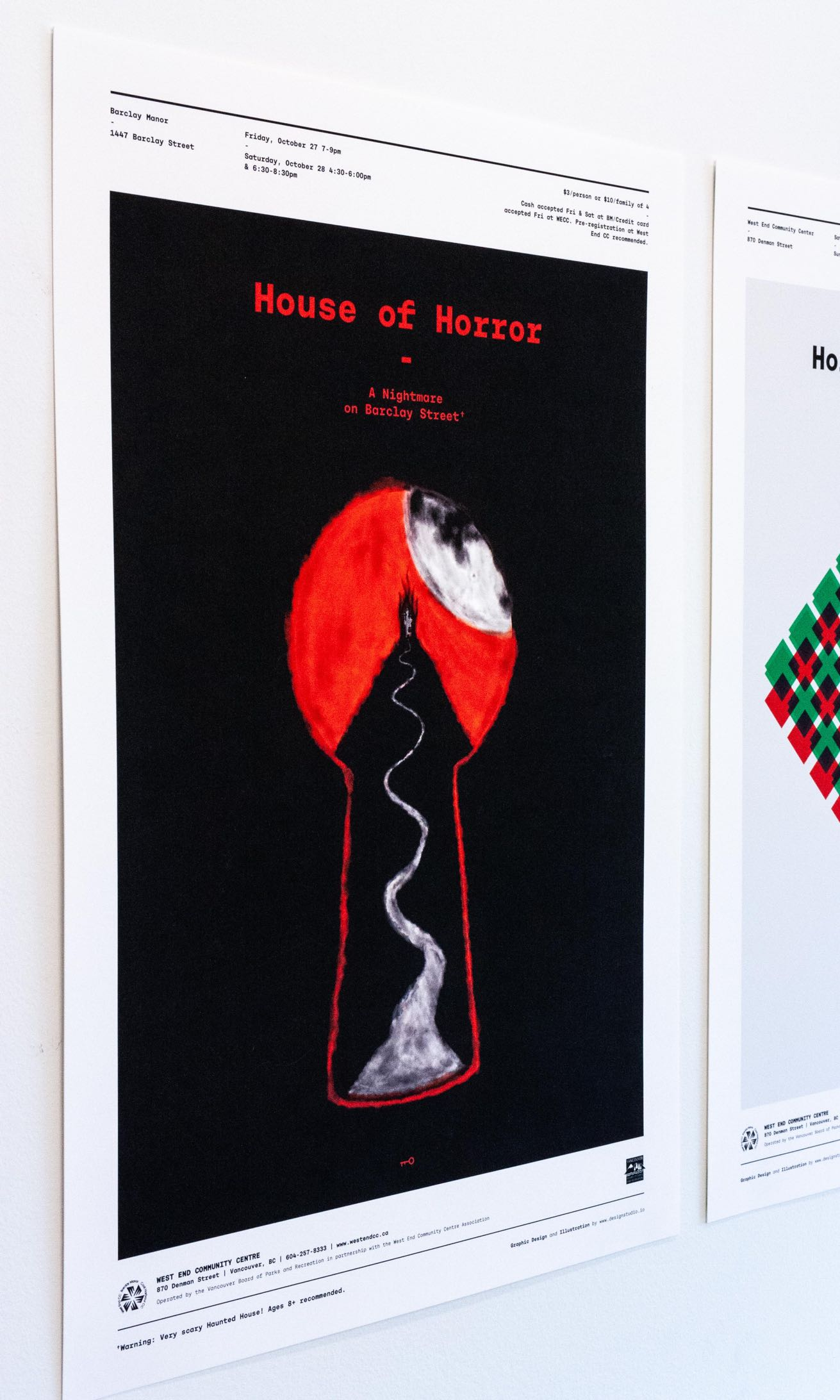 Poster with solid black back with a red keyhole in the middle, through which a haunted house is seen atop a mountain with full moon overlooking — by Dima Yagnyuk.